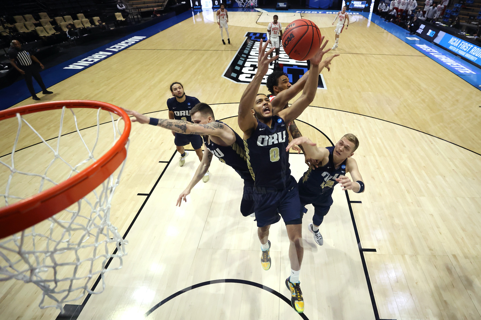 The Oral Roberts University Golden Eagles control a rebound during the NCAA Tournament.