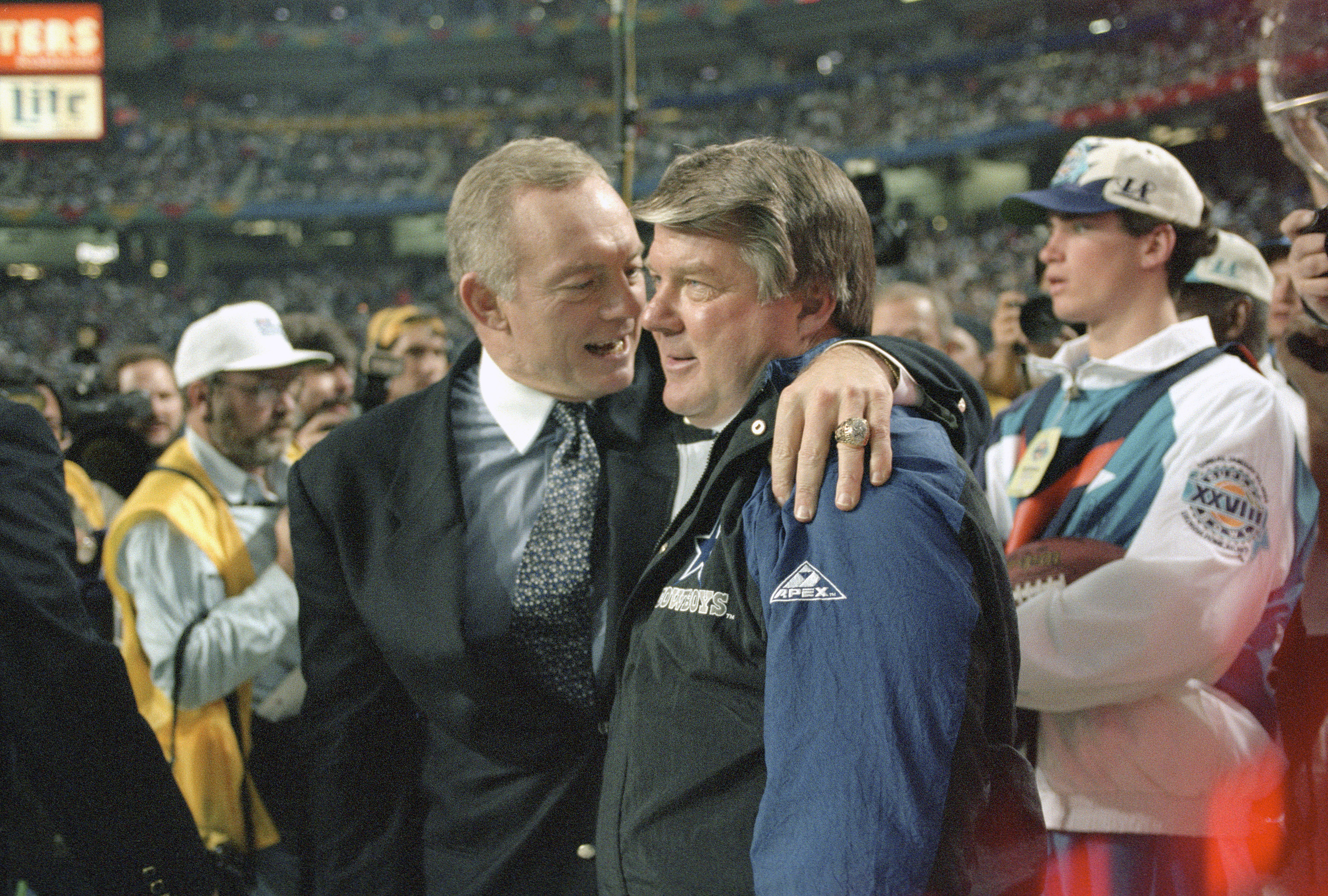 Owner Jerry Jones of the Dallas Cowboys (L) hugs head coach Jimmy Johnson as the Cowboys win Super Bowl XXVIII in 1994