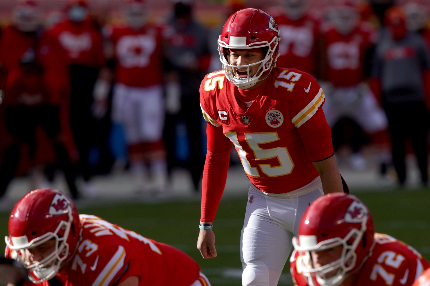 Patrick Mahomes of the Kansas City Chiefs prepares to take a snap in a 2021 playoff game against the Cleveland Browns.