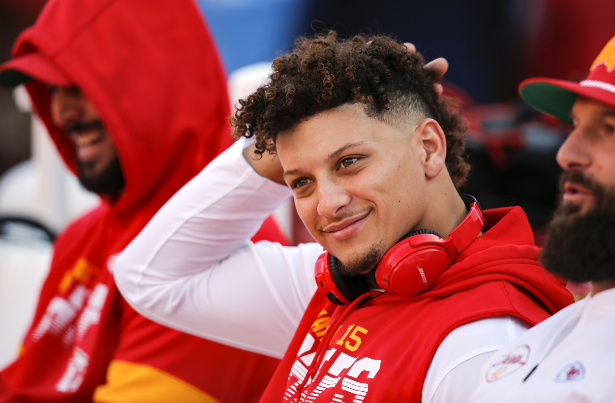 Patrick Mahomes sits on the bench during warmups before the Chiefs taken on the Packers.