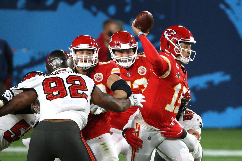 Kansas City Chiefs quarterback Patrick Mahomes attempts a pass while under pressure during Super Bowl 55.