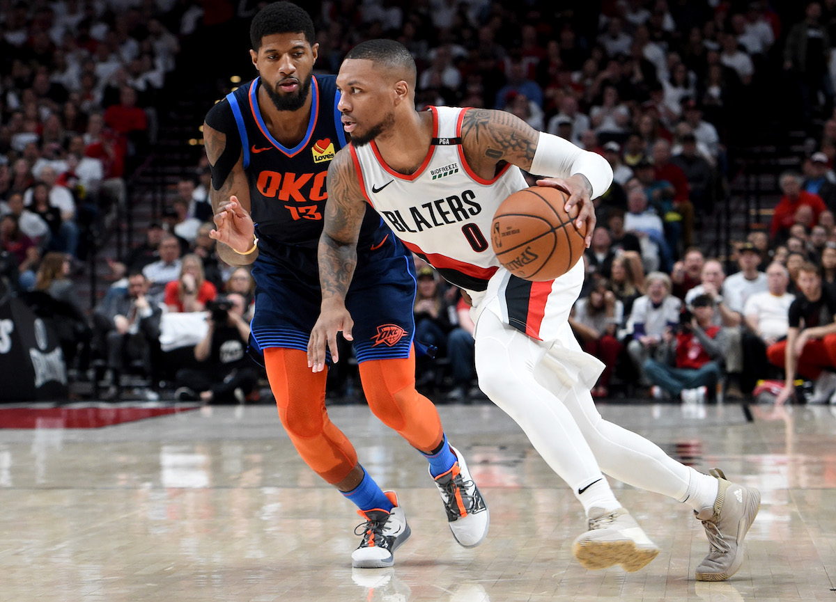NBA player Paul George defends Portland Trail Blazers guard Damian Lillard