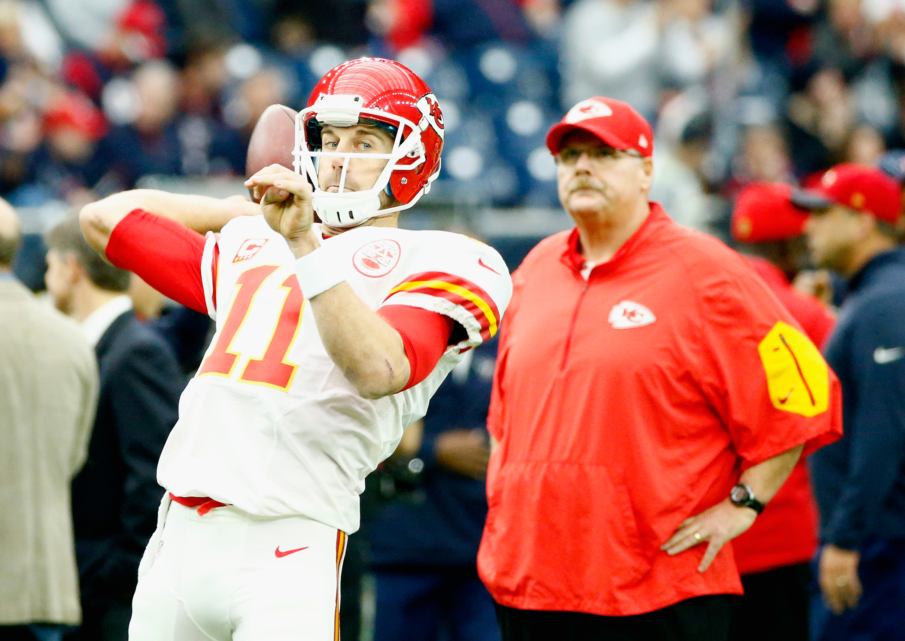 Quarterback Alex Smith of the Kansas City Chiefs looks to pass as head coach Andy Reid looks on in 2016