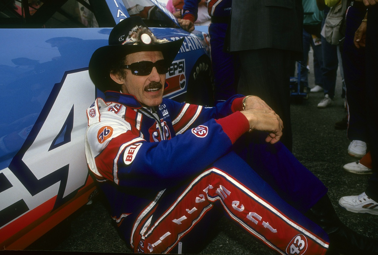Richard Petty sits by his famous No. 43 car ahead of the 1992 NASCAR Cup Series Daytona 500