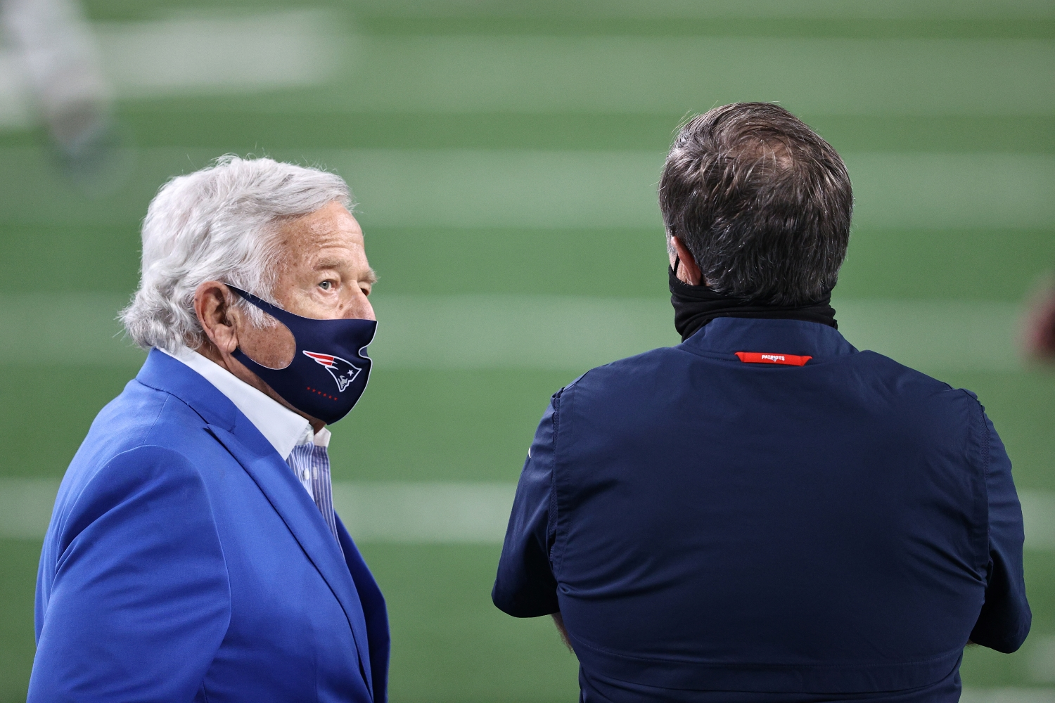 Patriots owner Robert Kraft stands next to head coach Bill Belichick during warmups before a game against the New York Jets from the 2020 NFL season.