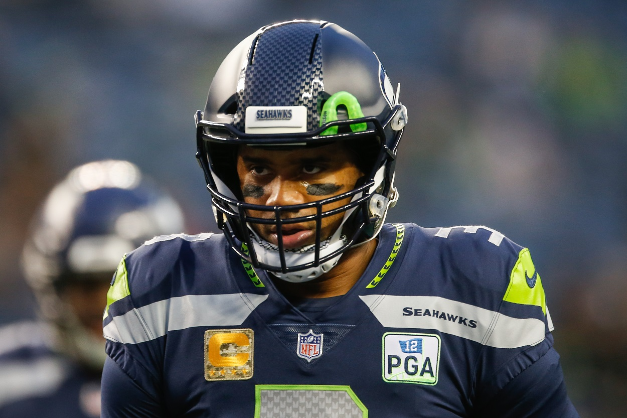 Russell Wilson on the field before the Seattle Seahawks face the Green Bay Packers.