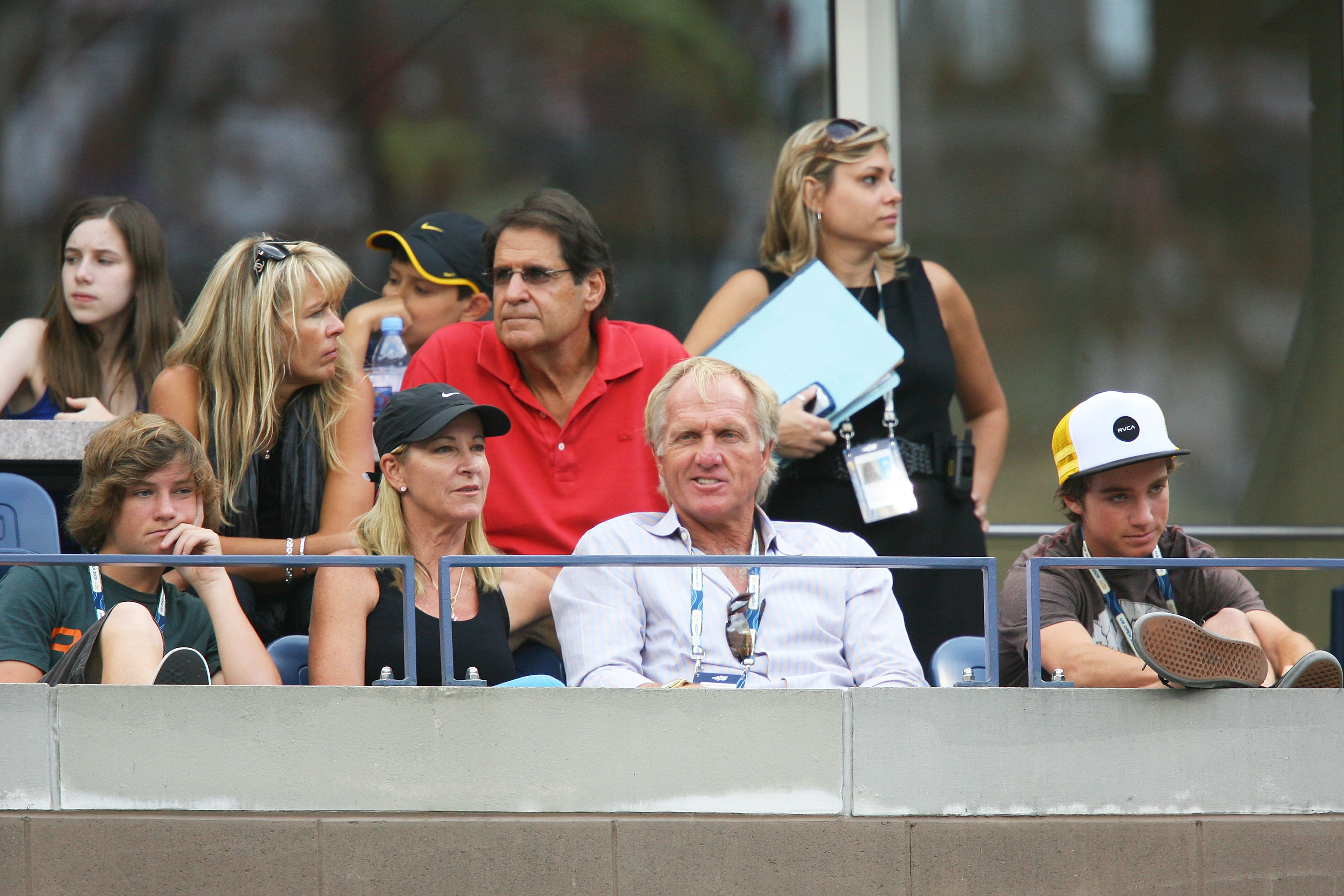 Former tennis pro Chris Evert and golfer Greg Norman watch the match in 2009