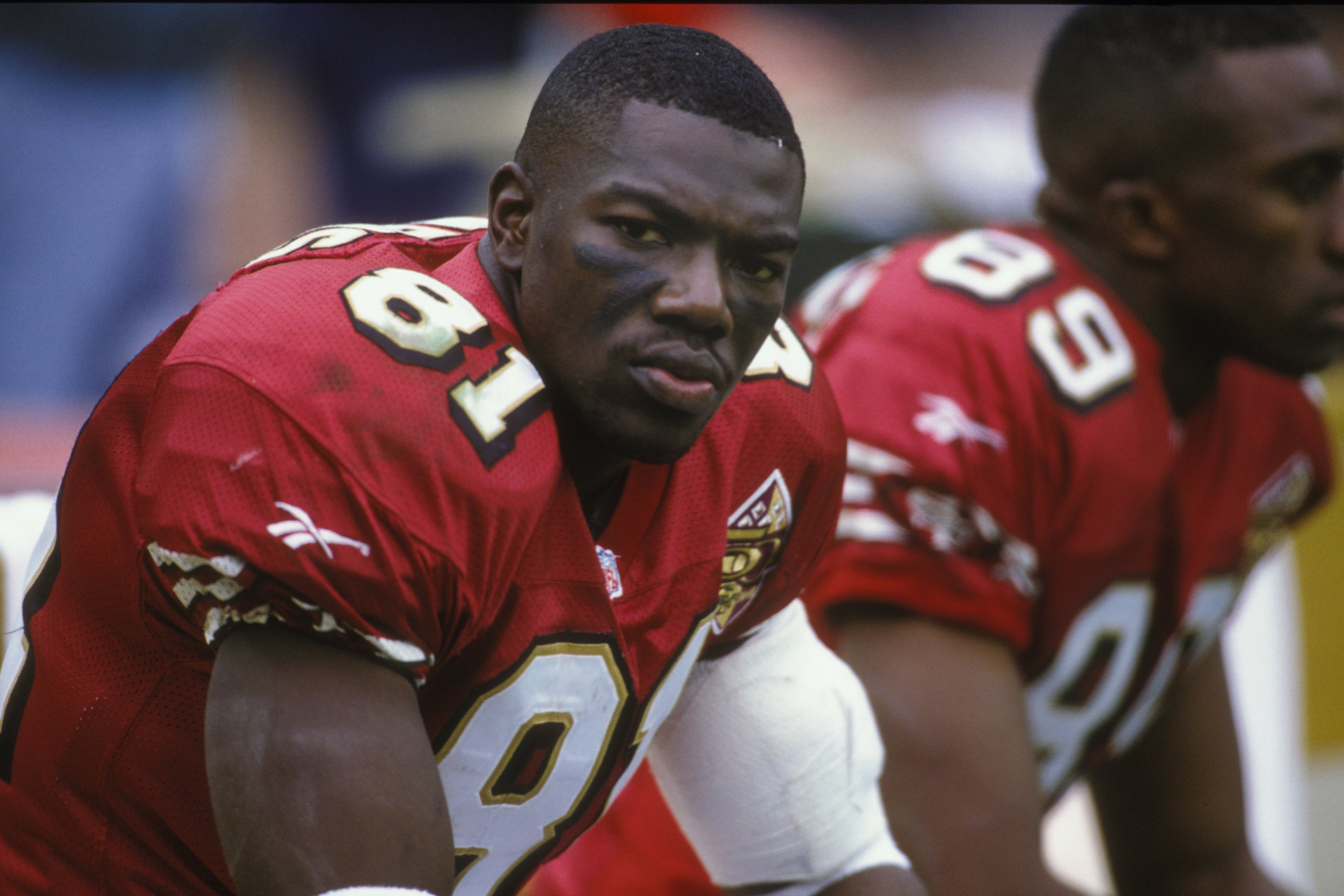 Terrell Owens looks on from the bench in 1996
