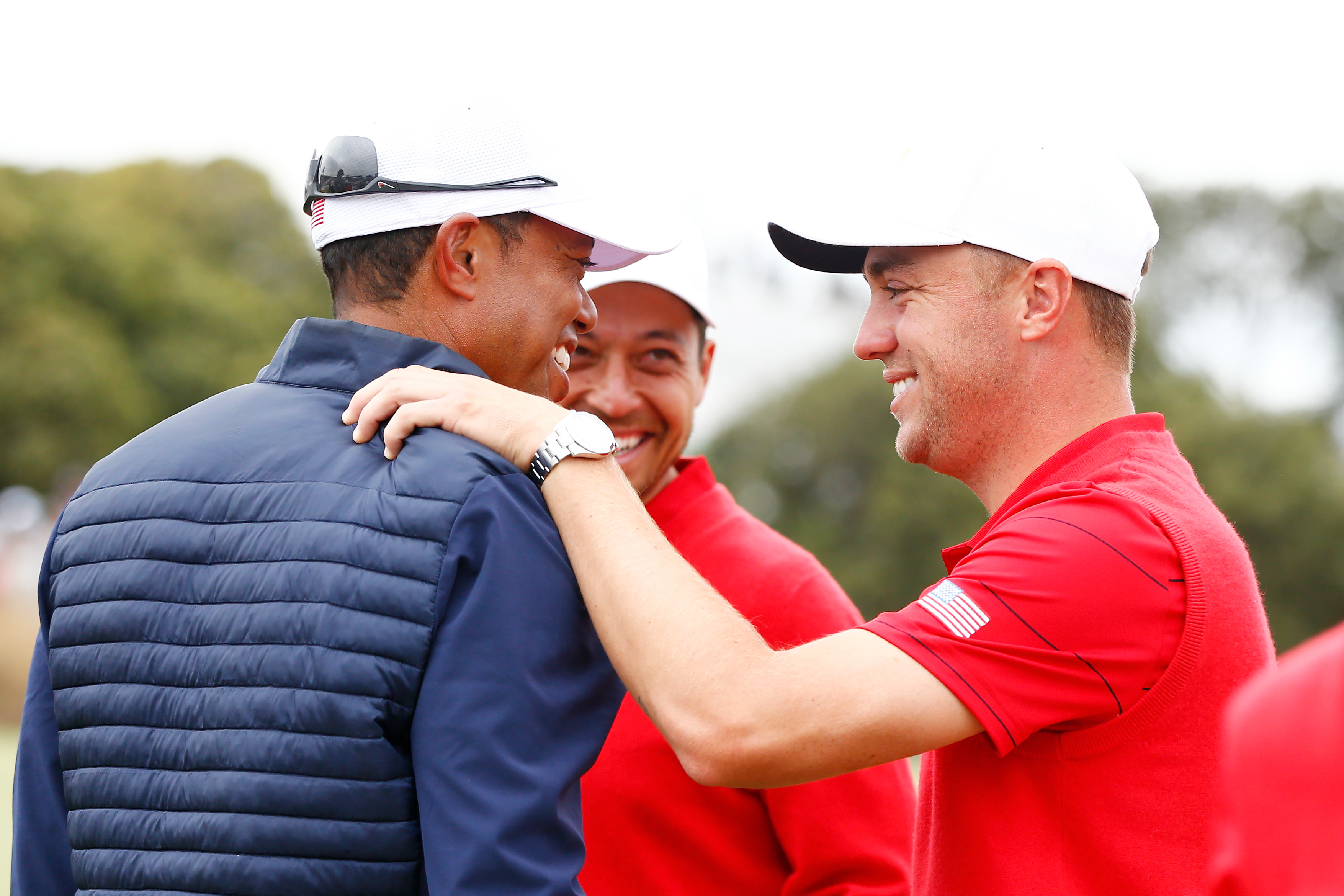 Tiger Woods and Justin Thomas celebrate after they won the 2019 Presidents Cup