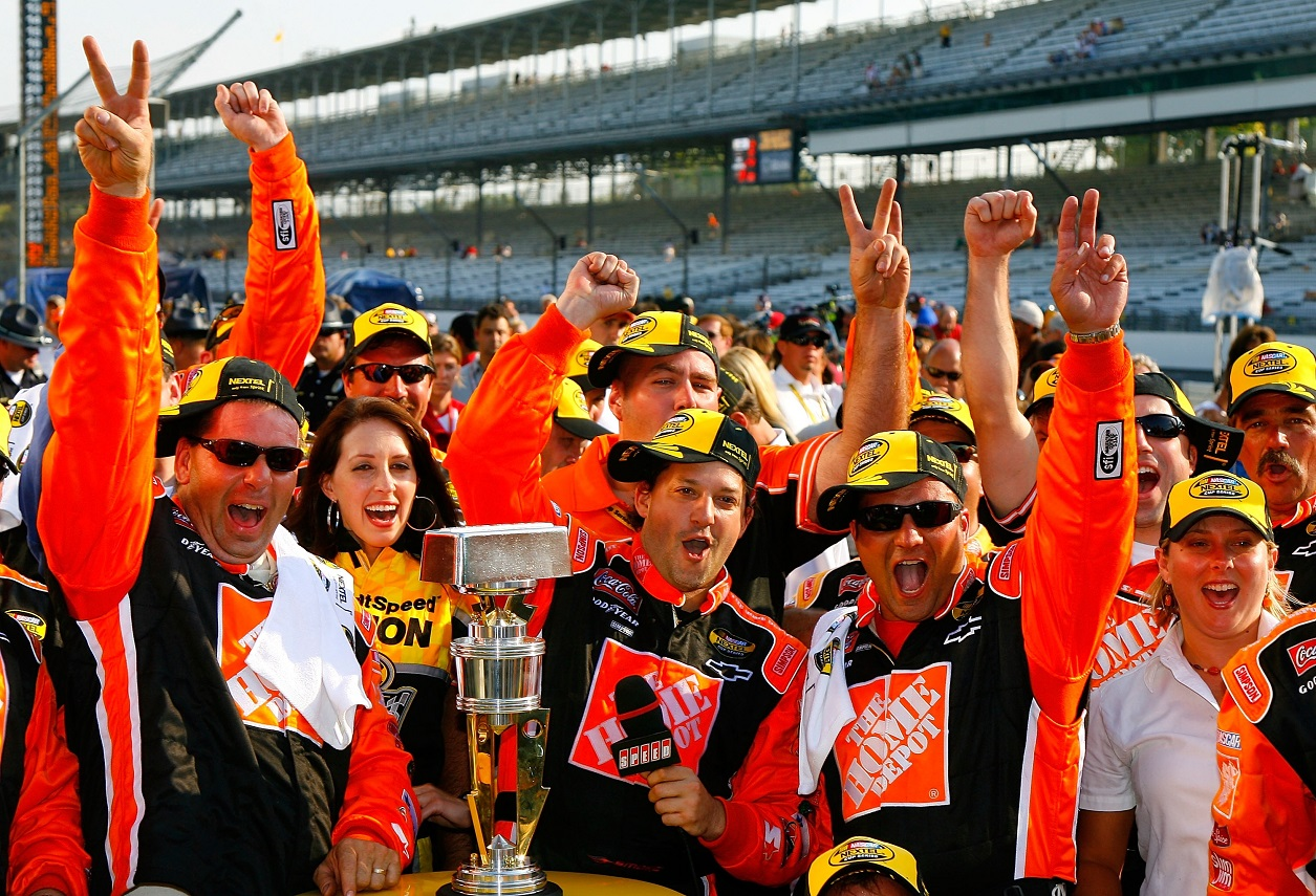 Tony Stewart and his crew celebrate their 2007 Brickyard 400 win