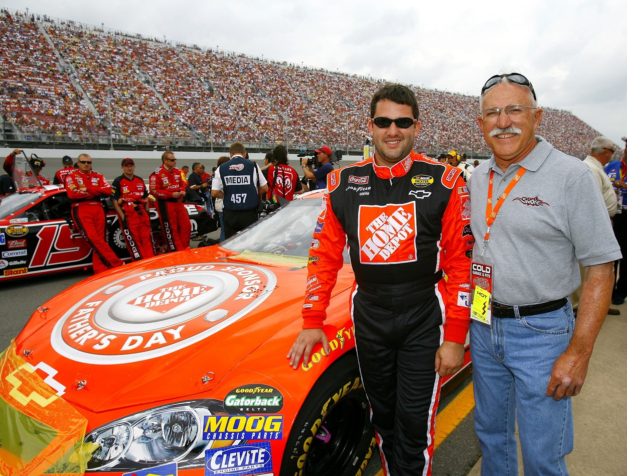 Tony Stewart poses for a photo with his dad before a NASCAR Cup Series race