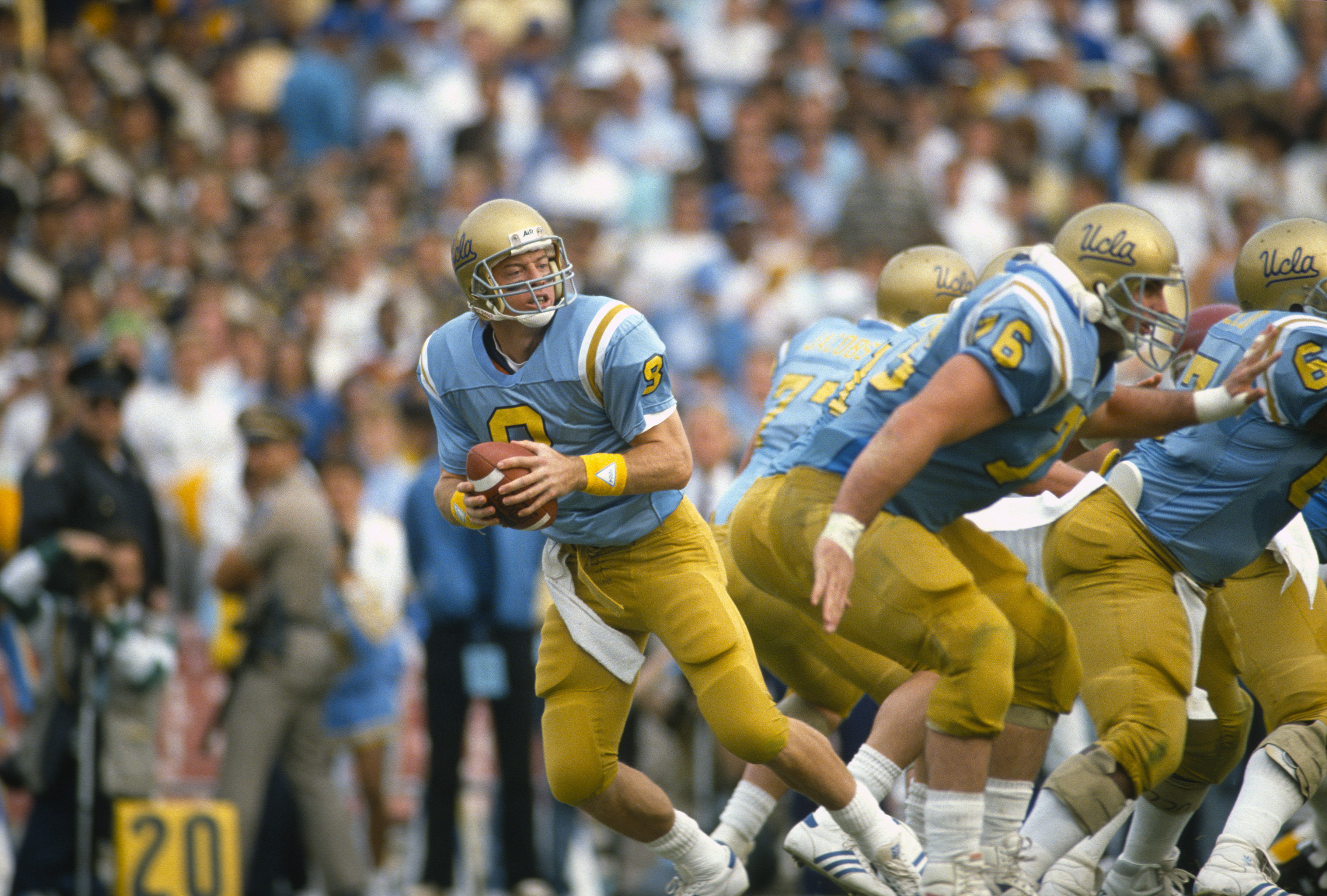 Troy Aikman of the UCLA Bruins drops back to pass in 1988