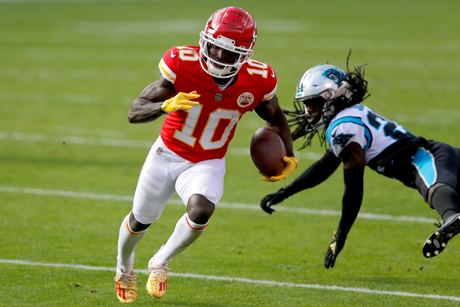 Tyreek Hill of the Kansas City Chiefs carries the ball after making a catch against the Carolina Panthers in the second quarter at Arrowhead Stadium.