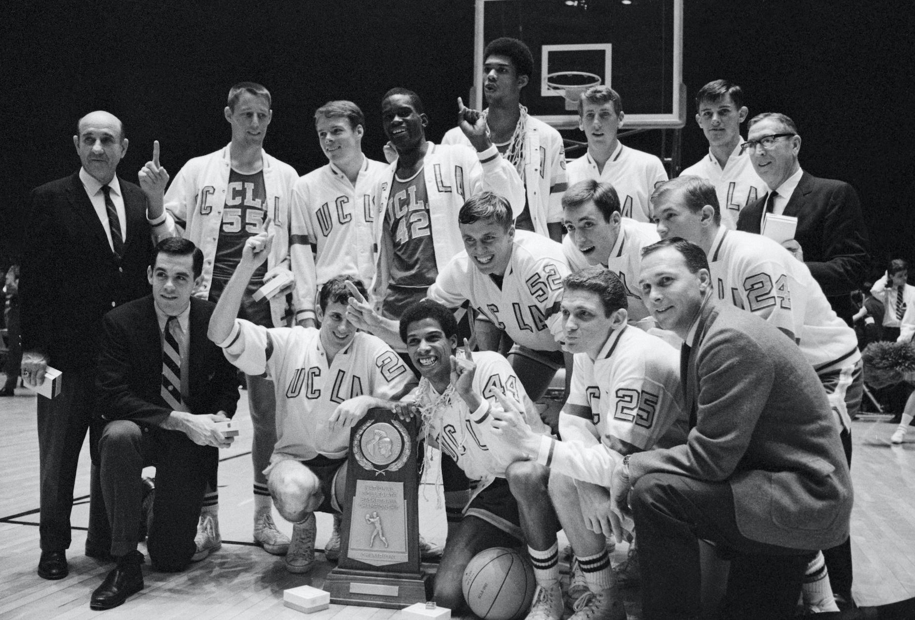 The UCLA Bruins men's basketball team celebrates winning the NCAA championship in 1967.