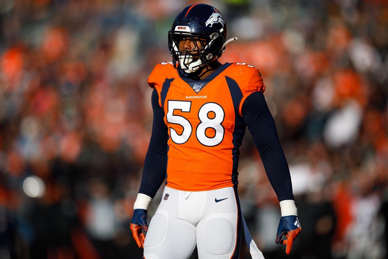 Denver Broncos LB Von Miller stands on the field