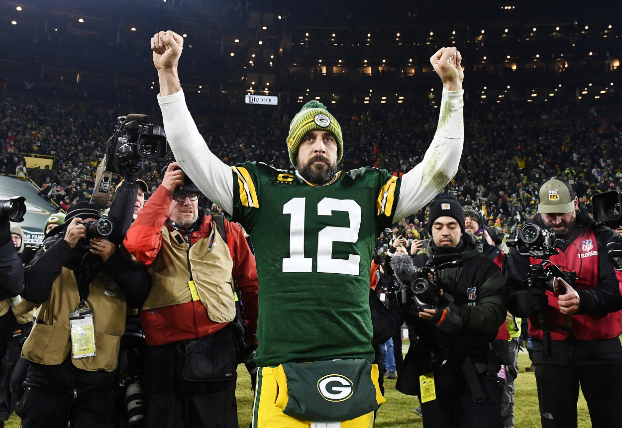 Green Bay Packers quarterback Aaron Rodgers celebrating a playoff win.