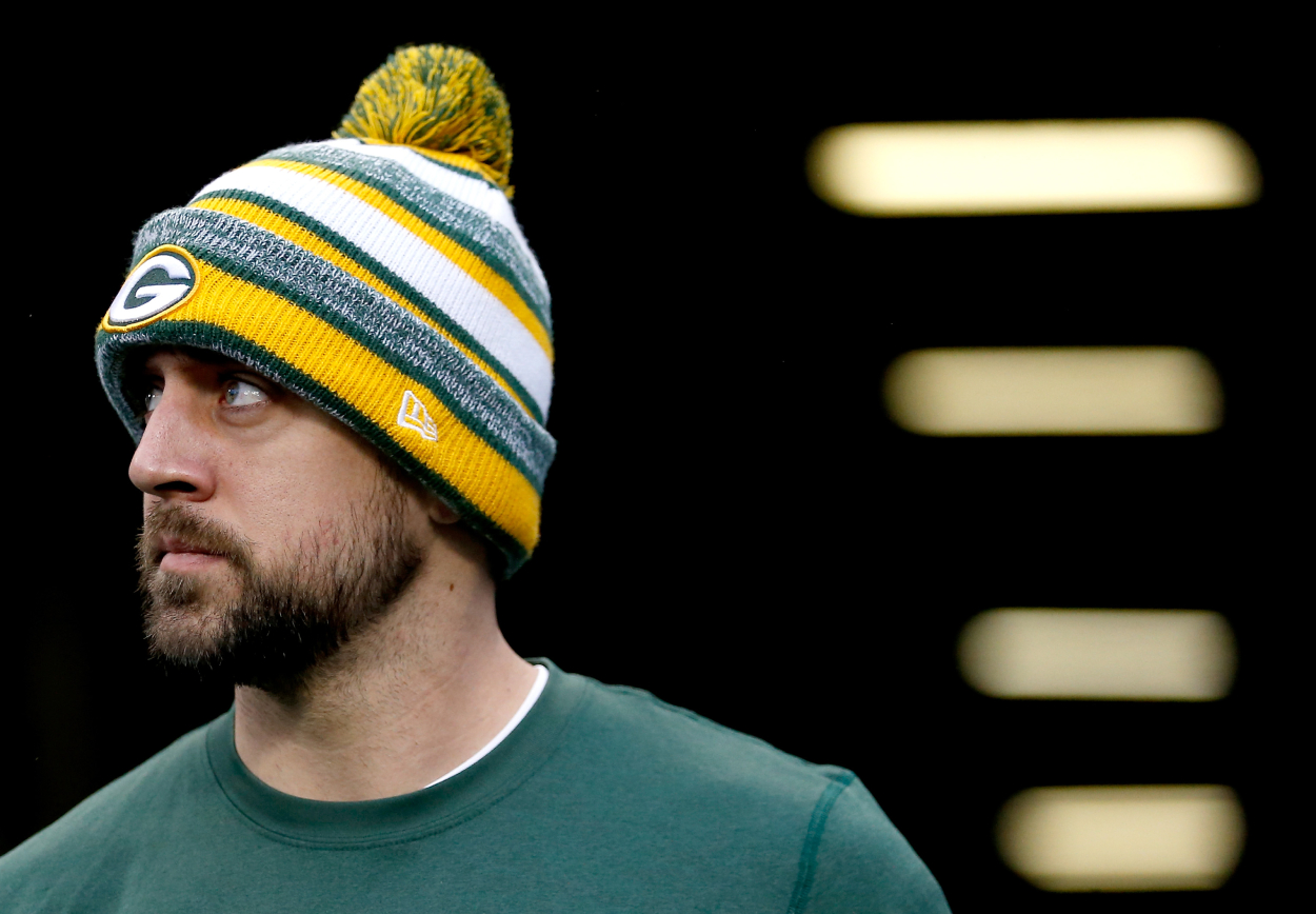 Green Bay Packers quarterback Aaron Rodgers, who still hasn't seen the Packers restructure his contract.