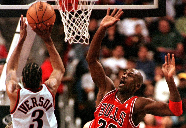 Philadelphia 76ers guard Allen Iverson shoots over Michael Jordan in 1998