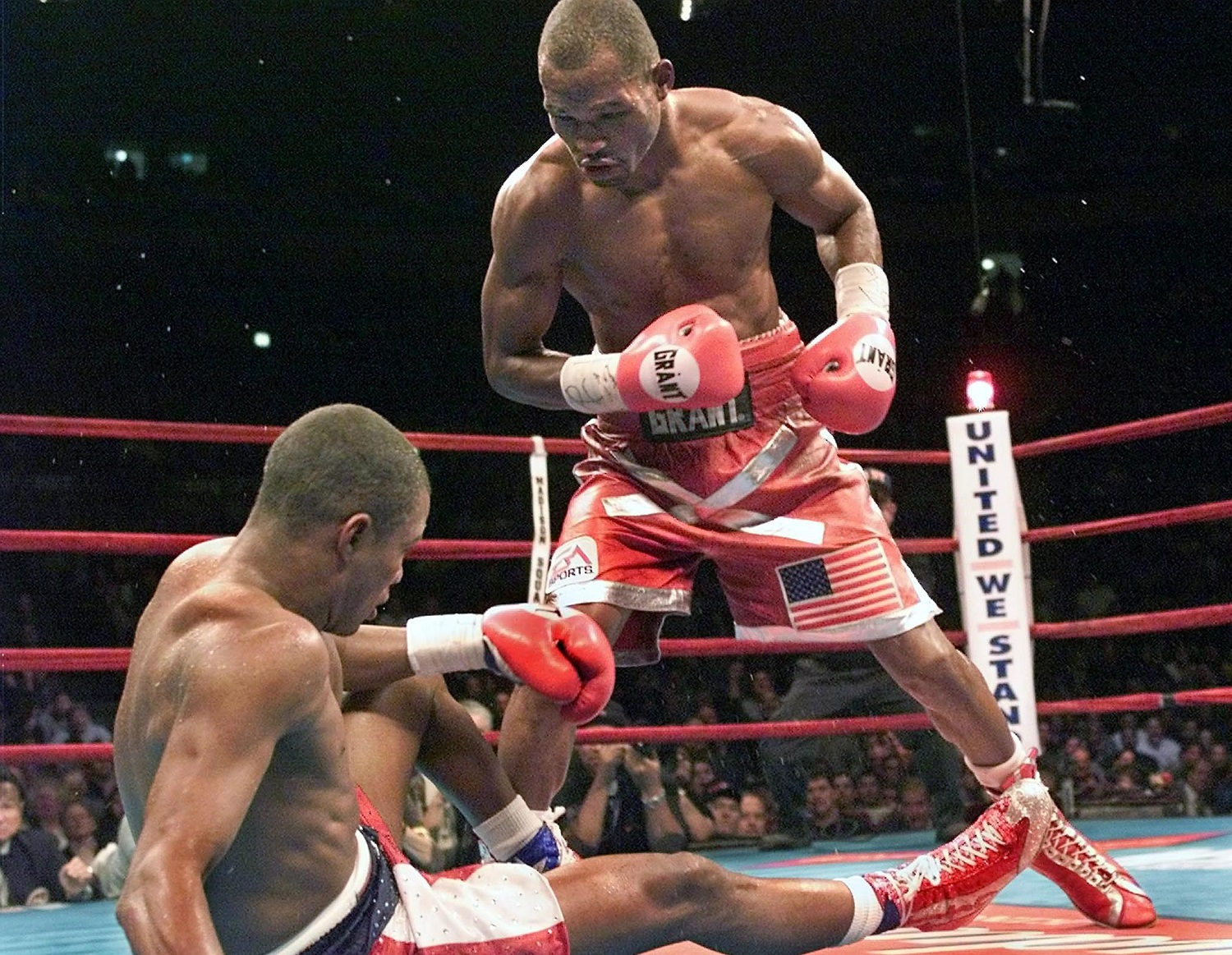 Bernard Hopkins, right, knocks down Felix Trinidad during their title unification match at Madison Square Garden on Sept. 29, 2001. Hopkins won by TKO in the 12th round to secure the undisputed middleweight championship. | Timothy A. Clary/AFP via Getty Images