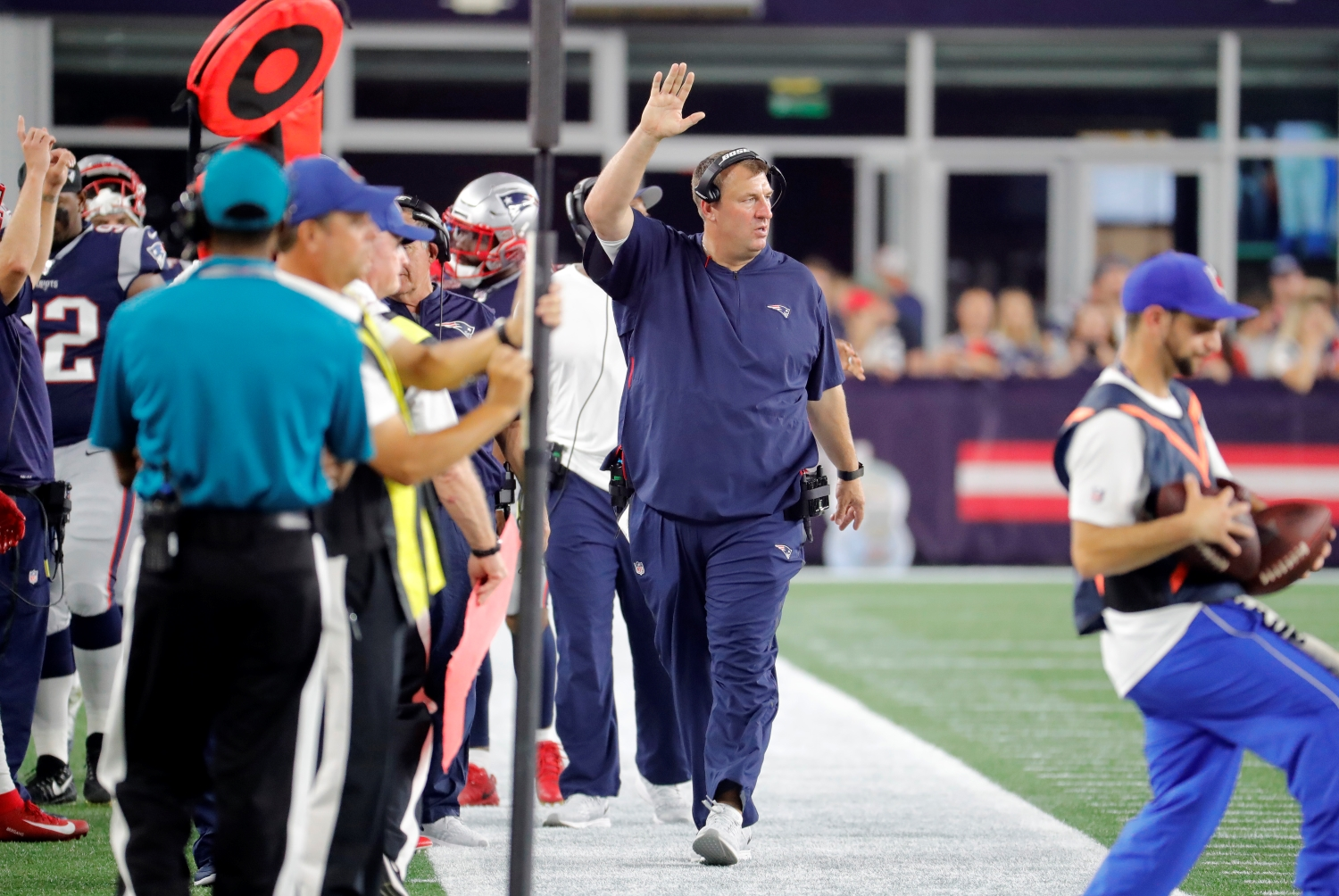 New England Patriots defensive line coach Bret Bielema walks on the sideline during a preseason game.