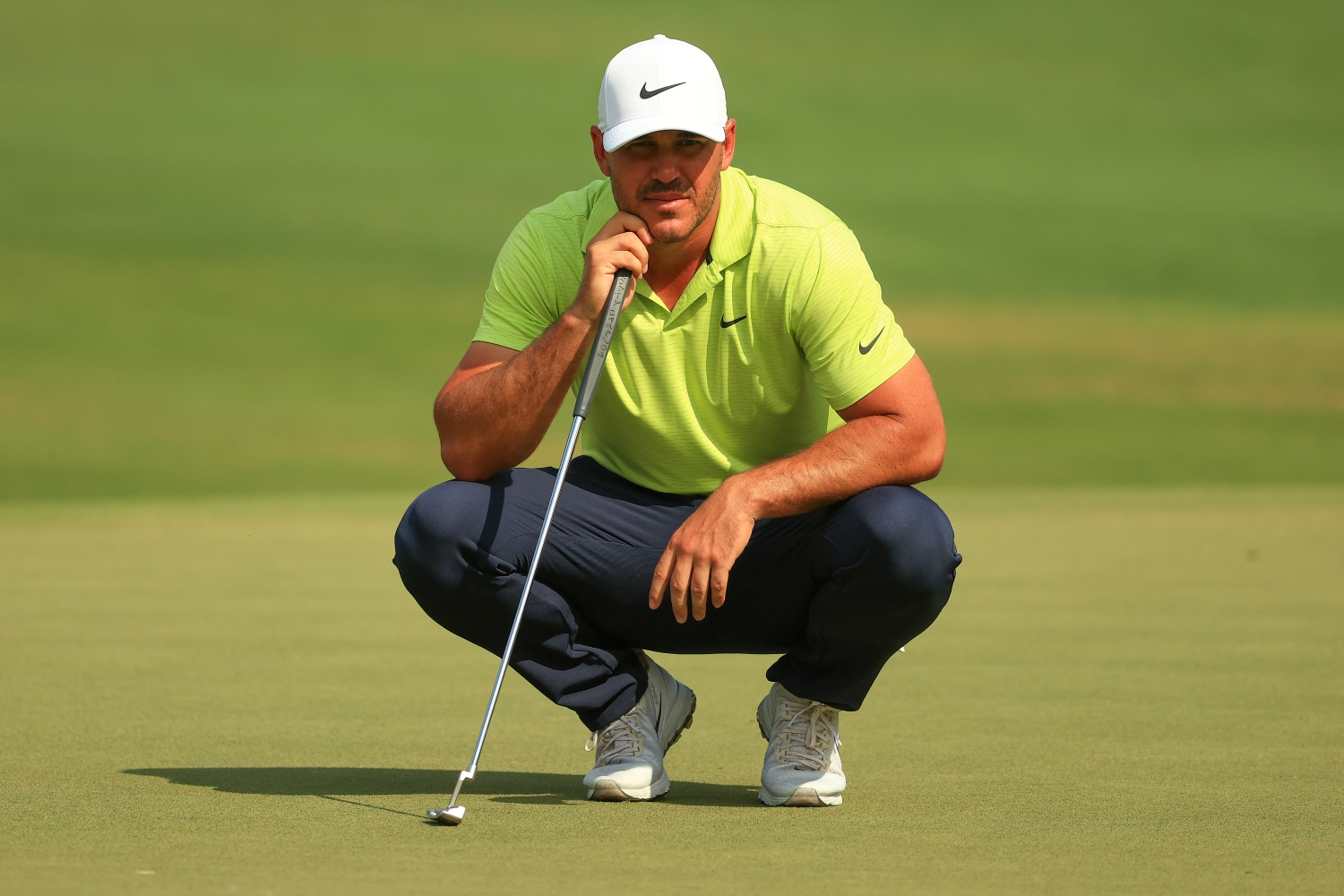 Brooks Koepka lines up a putt during the World Golf Championships-Workday Championship at The Concession.