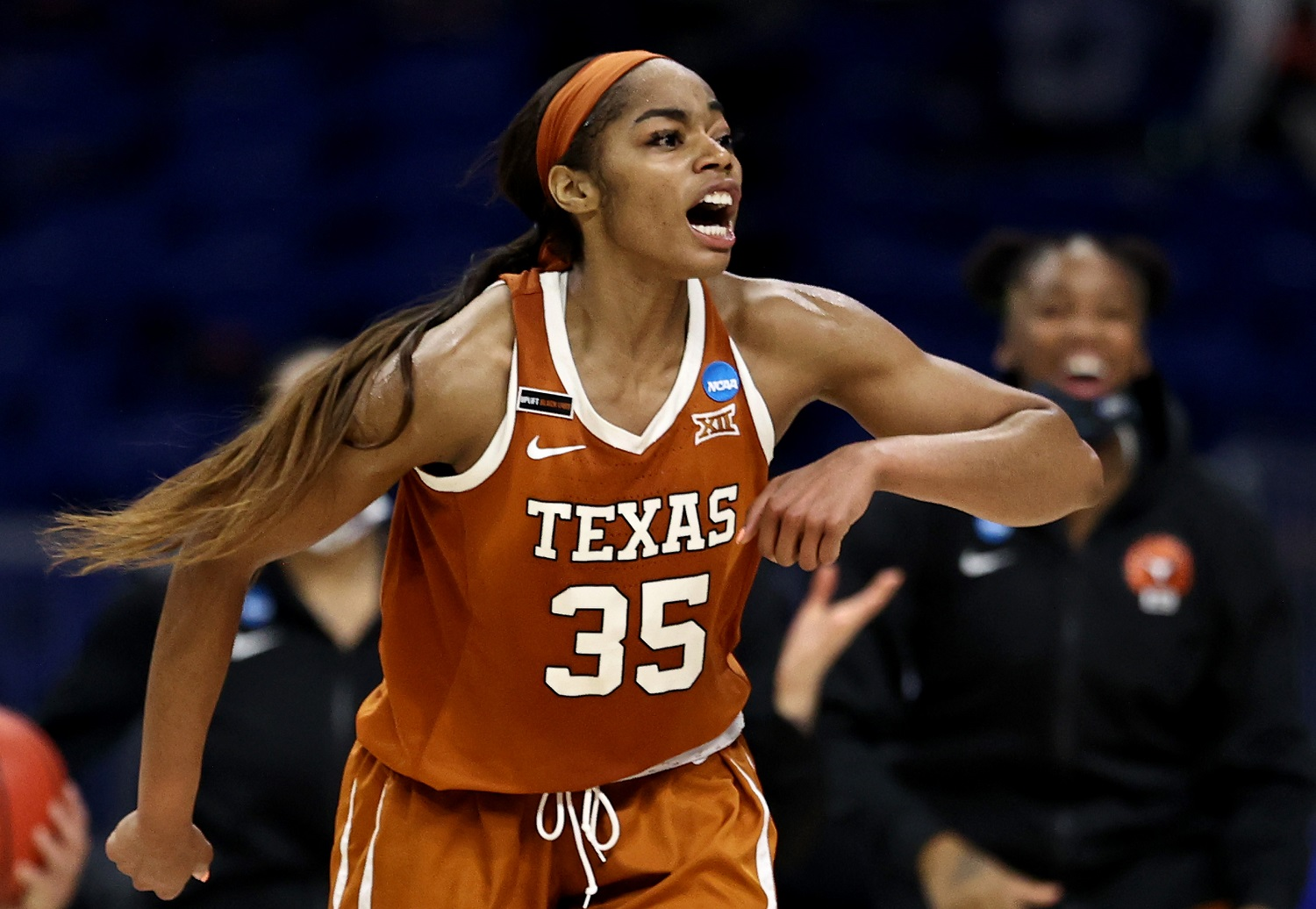 Charli Collier of the Texas Longhorns celebrates the lead late in the fourth quarter against the Maryland Terrapins during the NCAA Tournament Sweet 16 at the Alamodome. Elsa/Getty Images