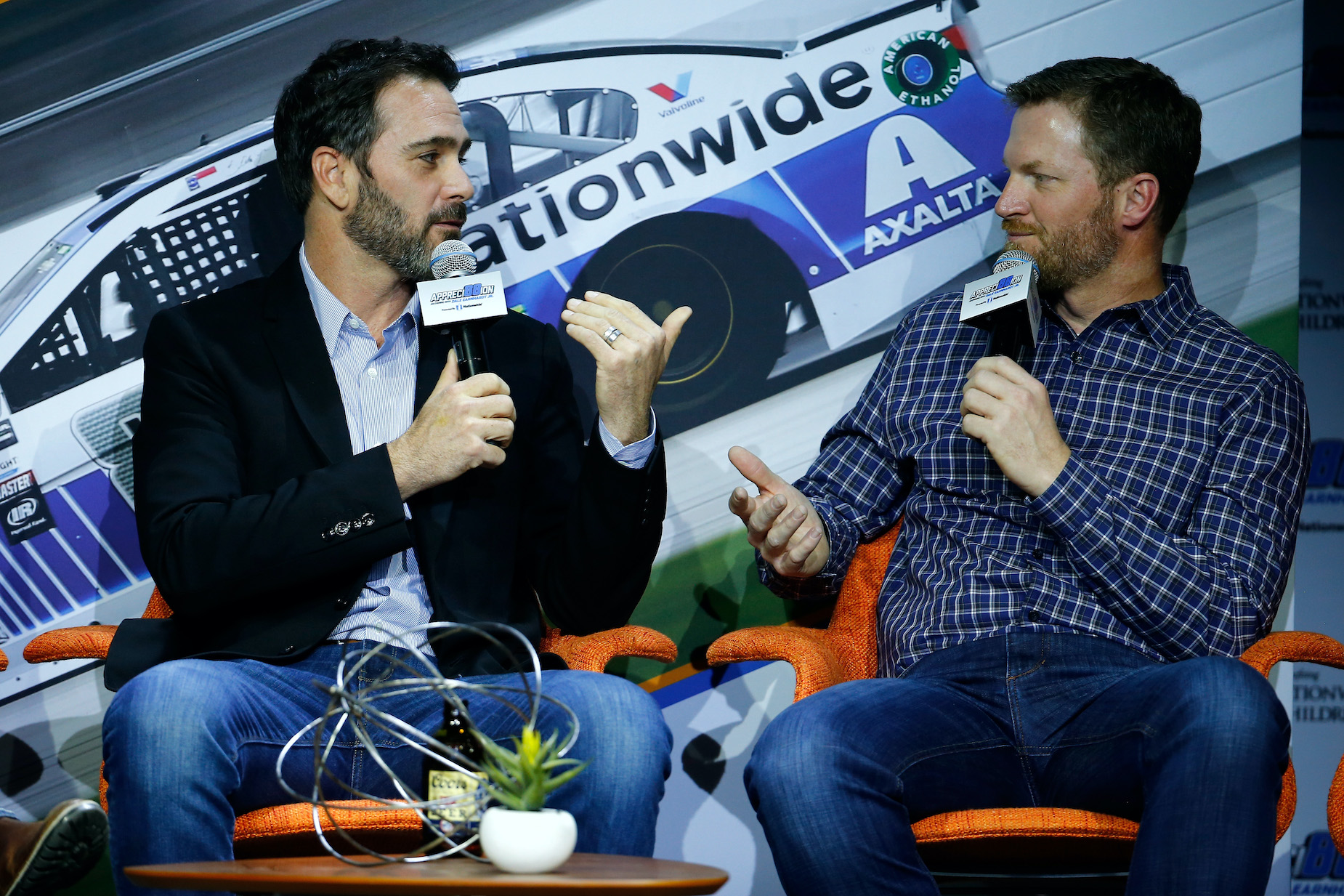 NASCAR drivers Jimmie Johnson (L) and Dale Earnhardt Jr. (R) talk at a 2017 event in Las Vegas.