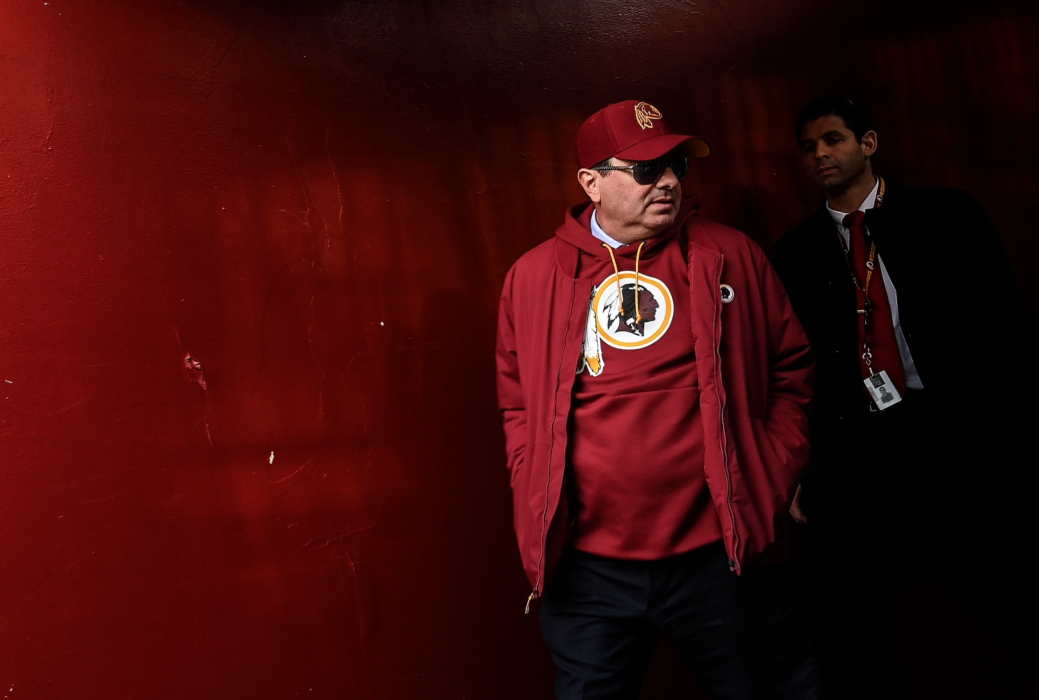 Washington Football Team owner Dan Snyder heads out to the field before a game.