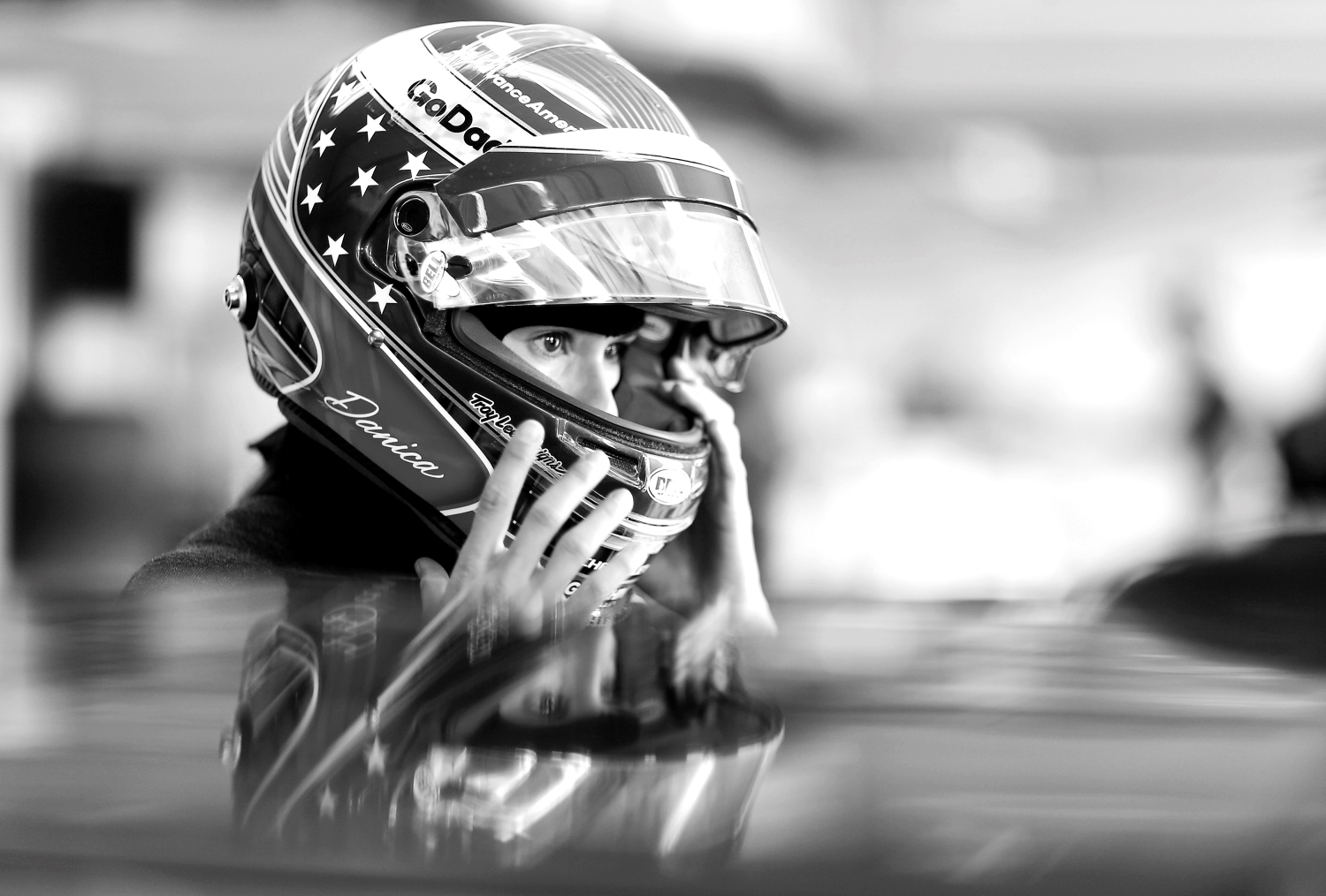 Danica Patrick adjusts her helmet during practice for the Indianapolis 500.