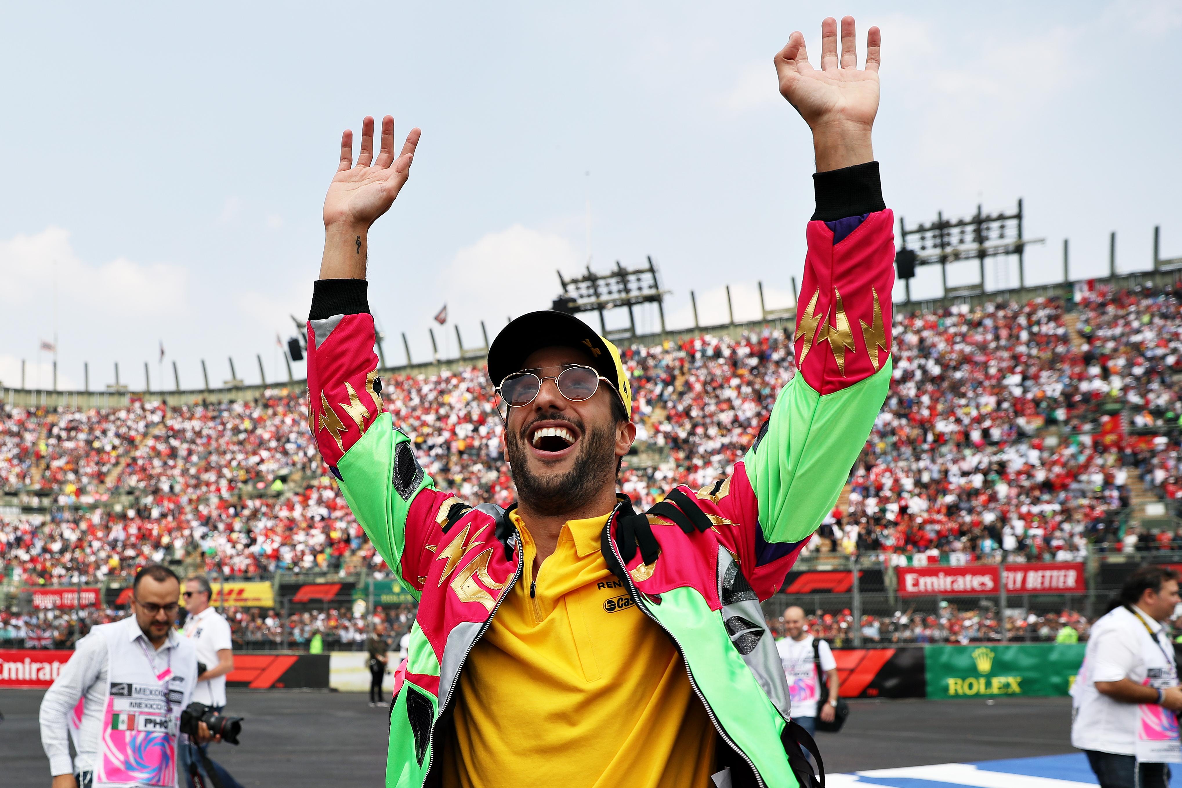 Daniel Ricciardo of Renault Sport F1 waves to the Formula 1 crowd on the drivers parade
