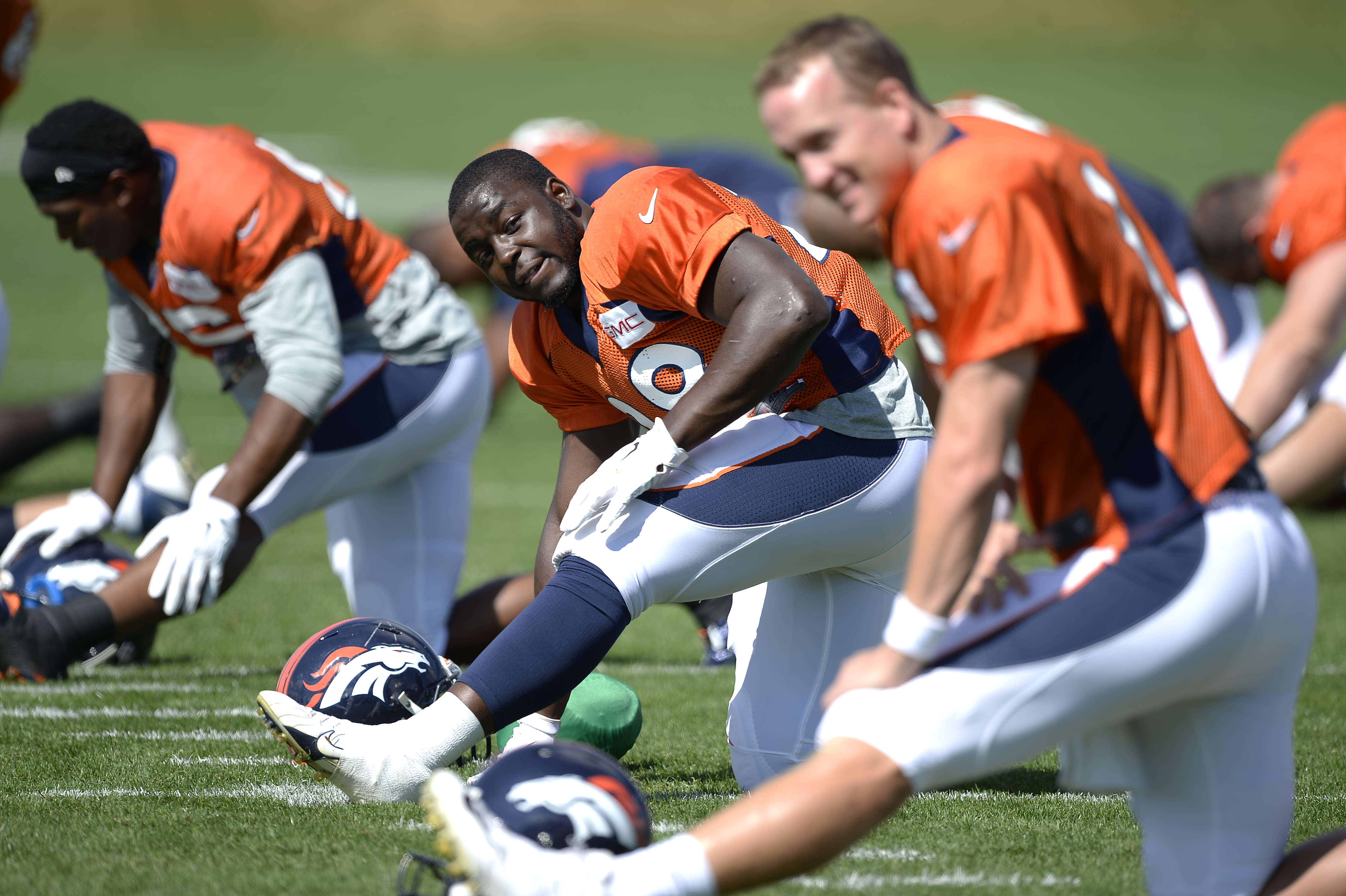 Denver Broncos running back Montee Ball stretches before practice