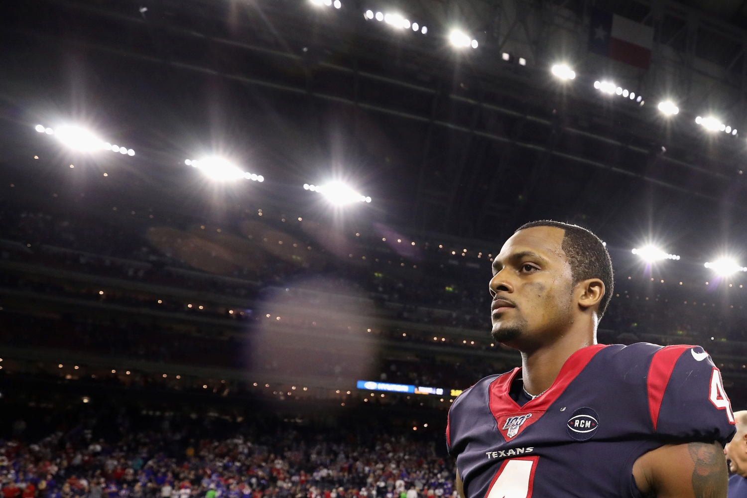 Deshaun Watson walks off the field after the Houston Texans lost to the Buffalo Bills in the playoffs on Jan. 4, 2020.