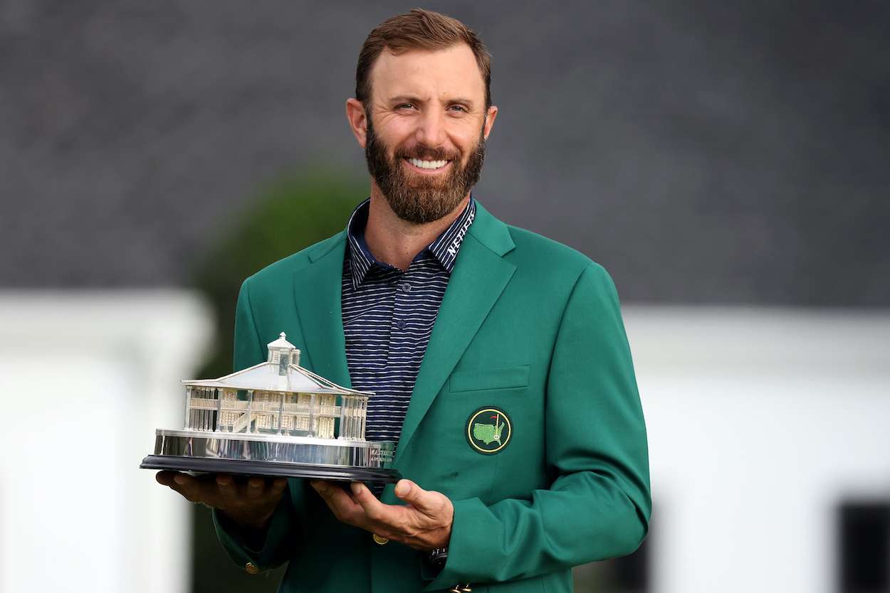 Dustin Johnson holds the Masters trophy