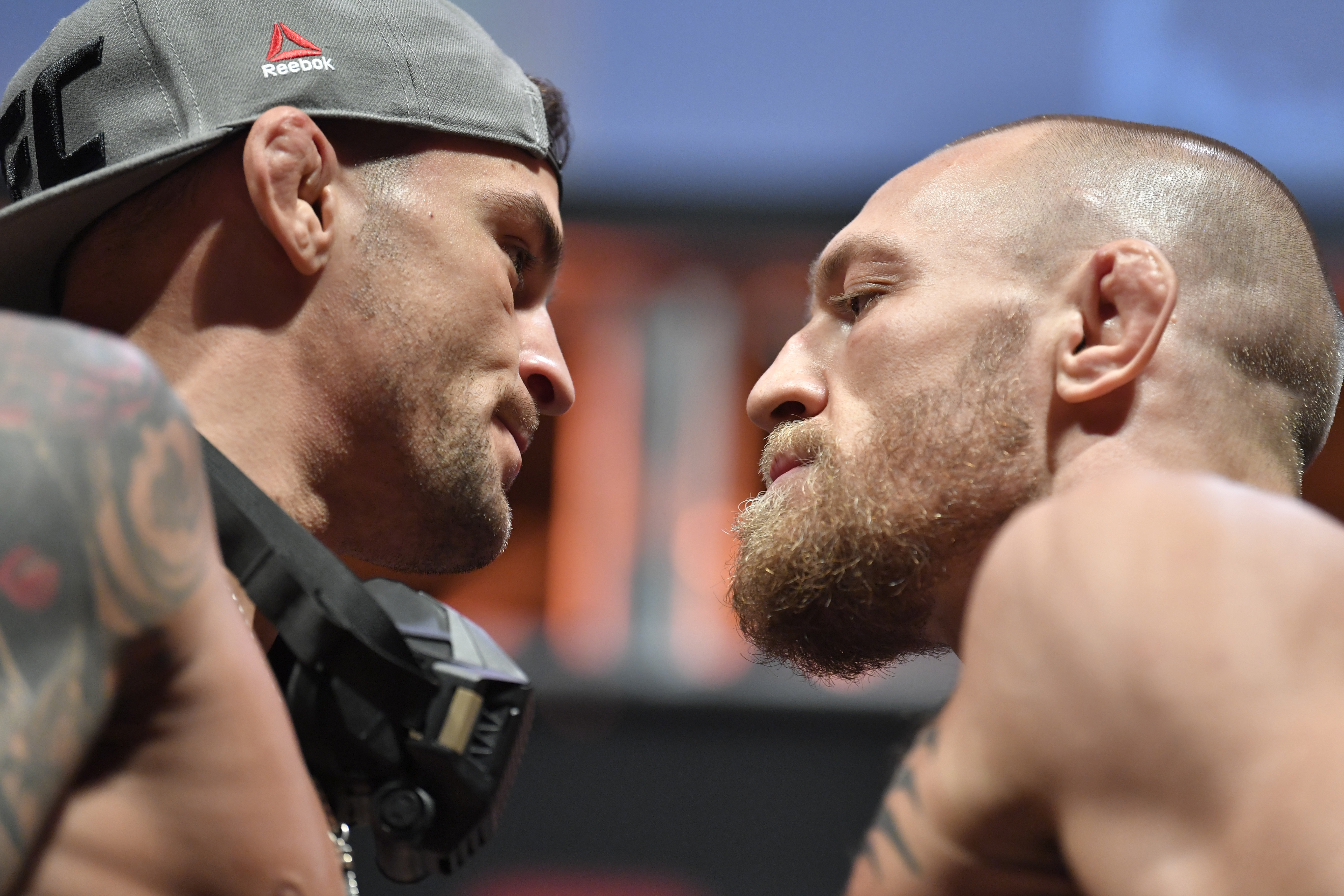 Opponents Dustin Poirier and Conor McGregor face off before UFC 257