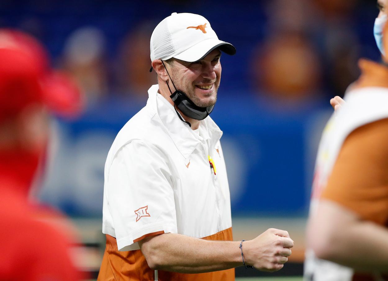 Former Texas Longhorns coach Tom Herman laughs