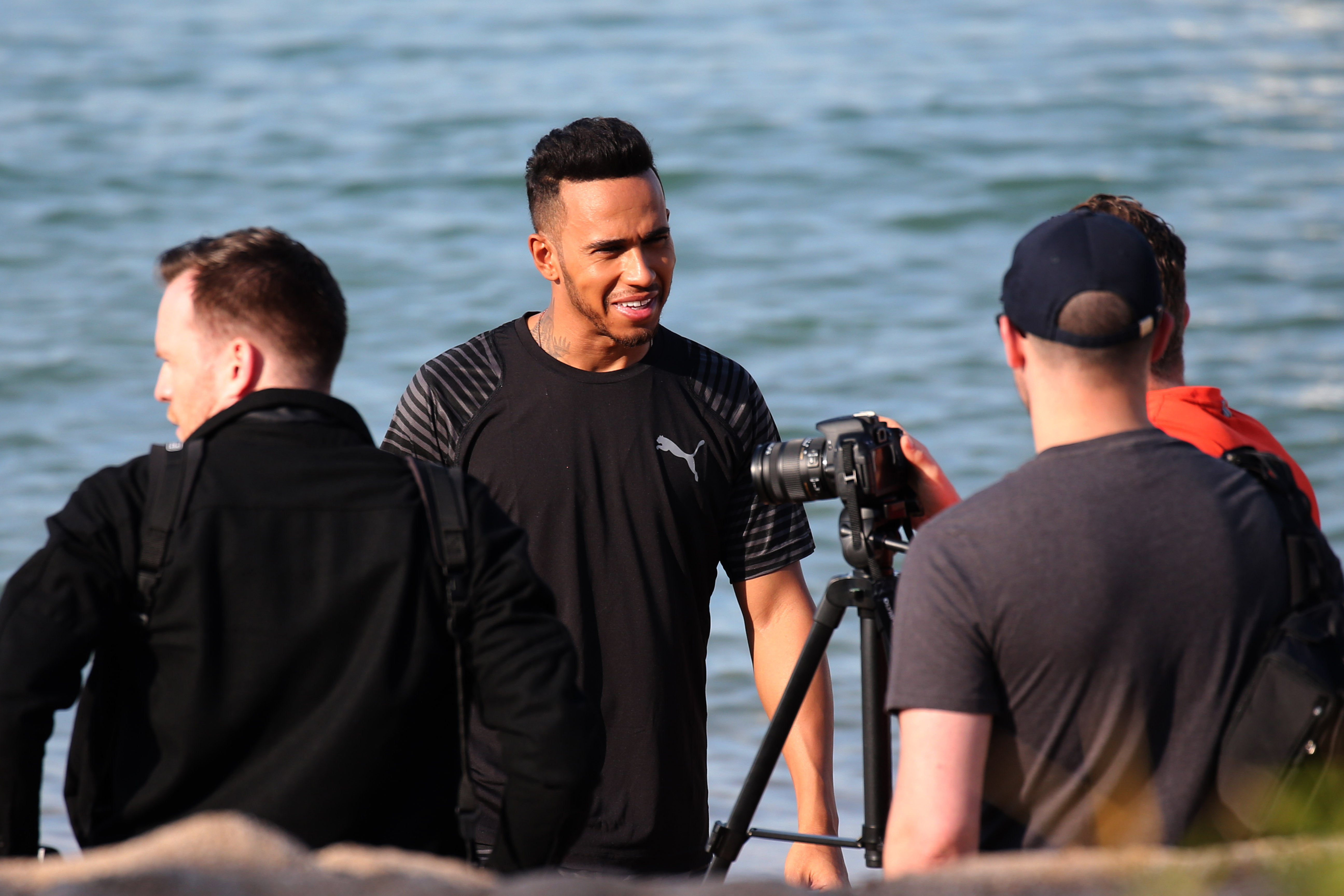 Lewis Hamilton seen during a fitness photo shoot at the beach