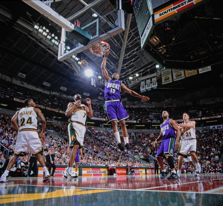 Milwaukee Bucks forward Glenn Robinson dunks against the Seattle SuperSonics.