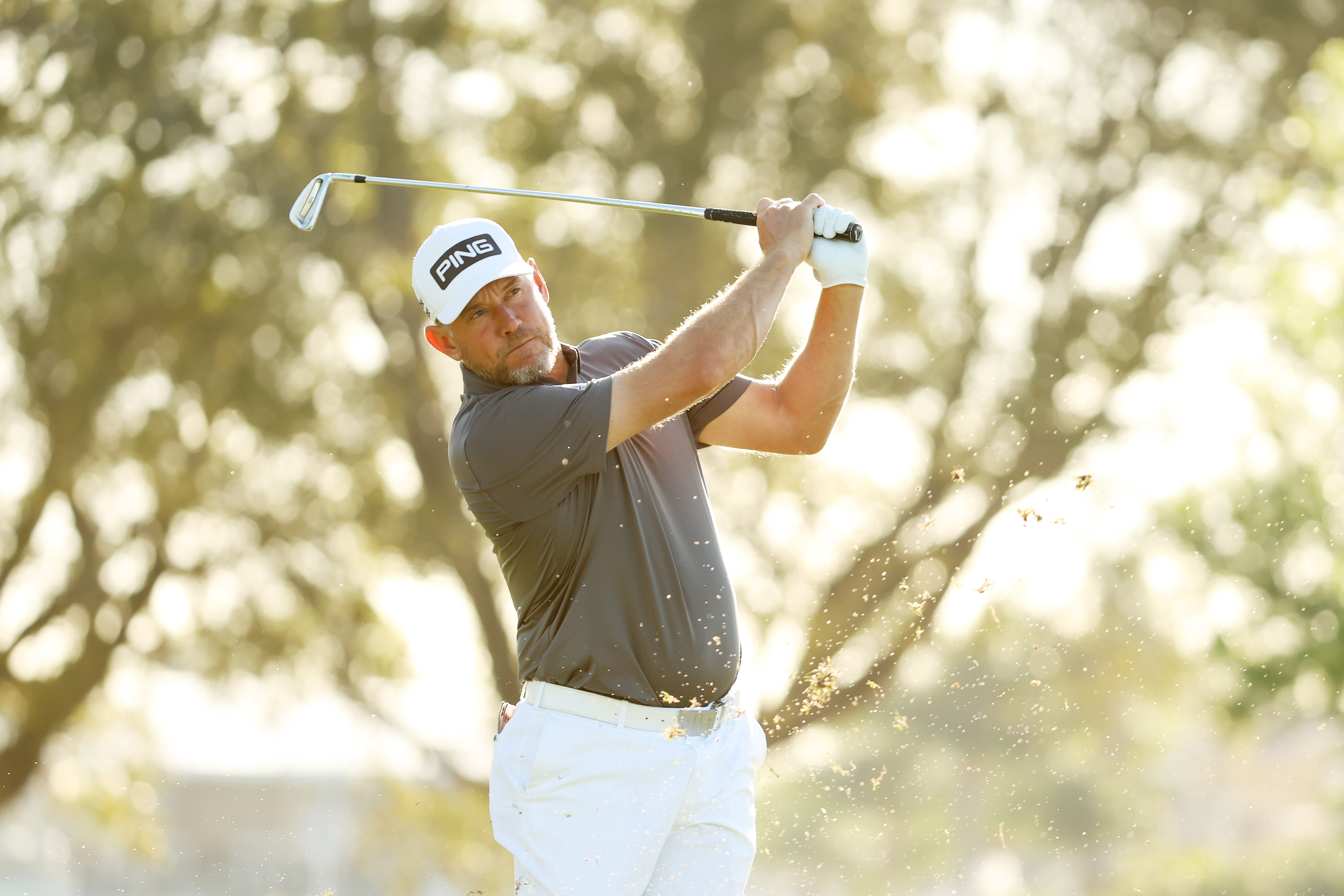 Lee Westwood plays a shot prior to The Honda Classic in 2021