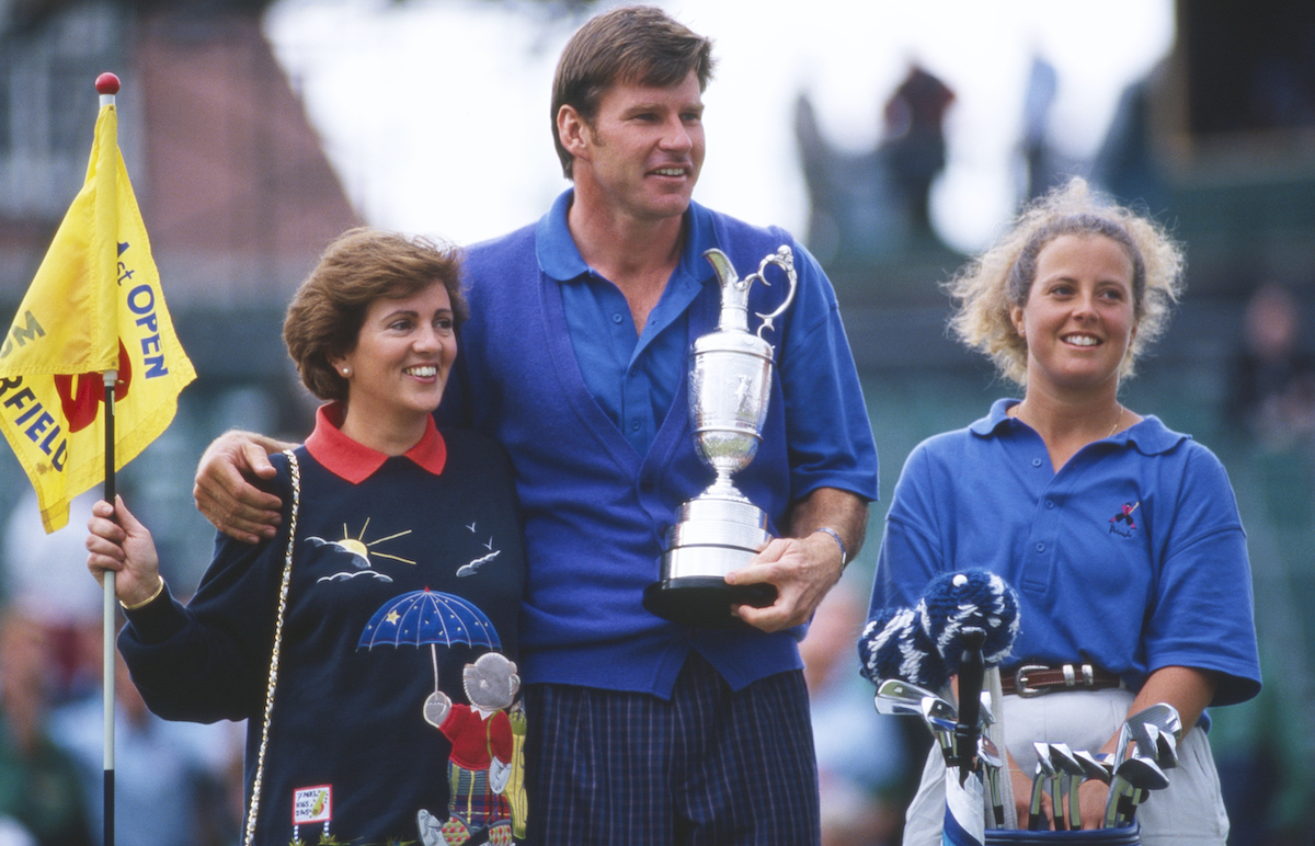 Nick Faldo holds the Claret Jug with wife Gill and caddie Fanny Sunesson following his win at the 1992 Open Championship