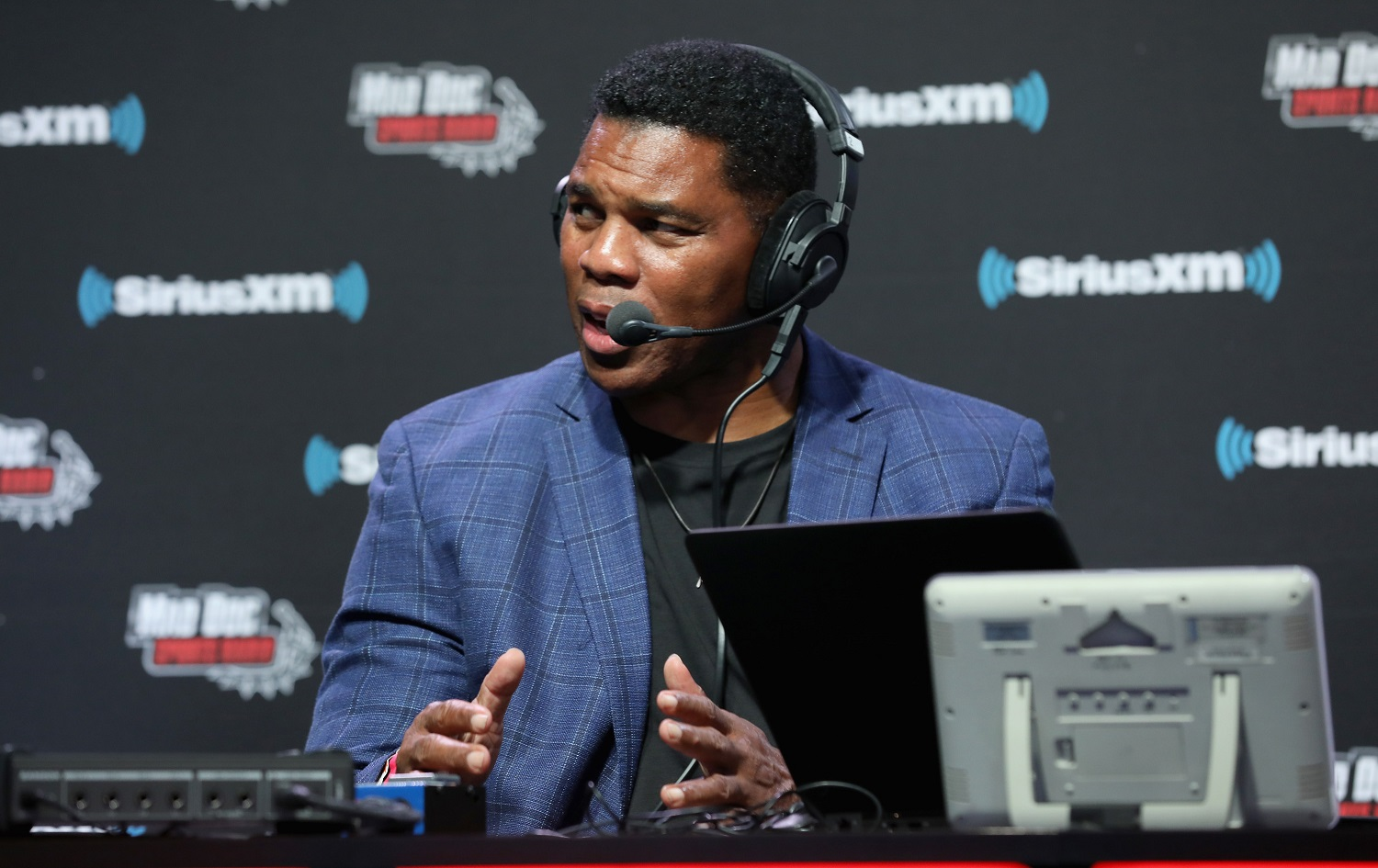 Retired college and pro football star Herschel Walker grew up in Georgia. He is considering a run for the U.S. Senate from the state. | Cindy Ord/Getty Images for SiriusXM