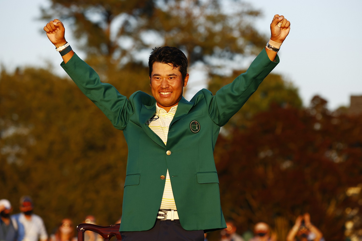 Hideki Matsuyama celebrates during the Green Jacket ceremony after winning The Masters at Augusta National Golf Club. | Jared C. Tilton/Getty Images