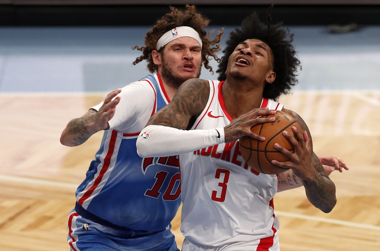Kevin Porter Jr. of the Houston Rockets in action against Tyler Johnson of the Brooklyn Nets at Barclays Center on March 31, 2021 in New York City. | Jim McIsaac/Getty Images