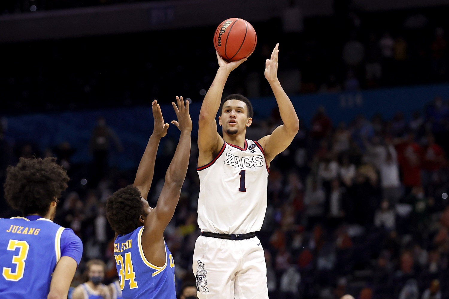 Jalen Suggs of the Gonzaga Bulldogs shoots the game-winning 3-pointer in overtime to defeat the UCLA Bruins, 93-90, during the 2021 NCAA Tournament semifinal at Lucas Oil Stadium in Indianapolis. | Photo by Jamie Squire/Getty Images
