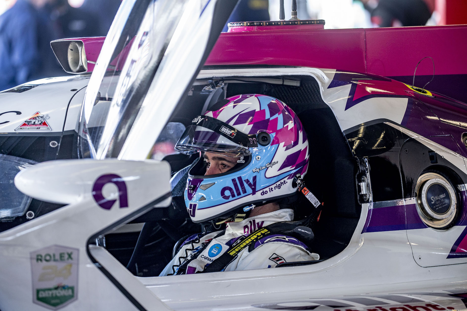 NASCAR legend Jimmie Johnson sits in his IndyCar in January 2021