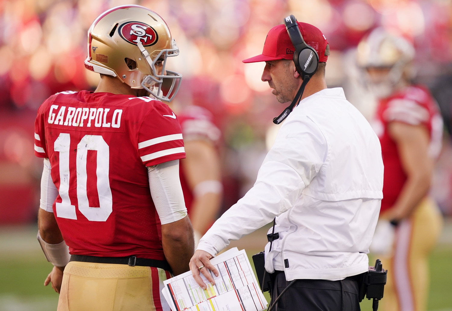 San Francisco 49ers quarterback Jimmy Garoppolo speaks to head coach Kyle Shanahan during a 2020 playoff game against the Minnesota Vikings.