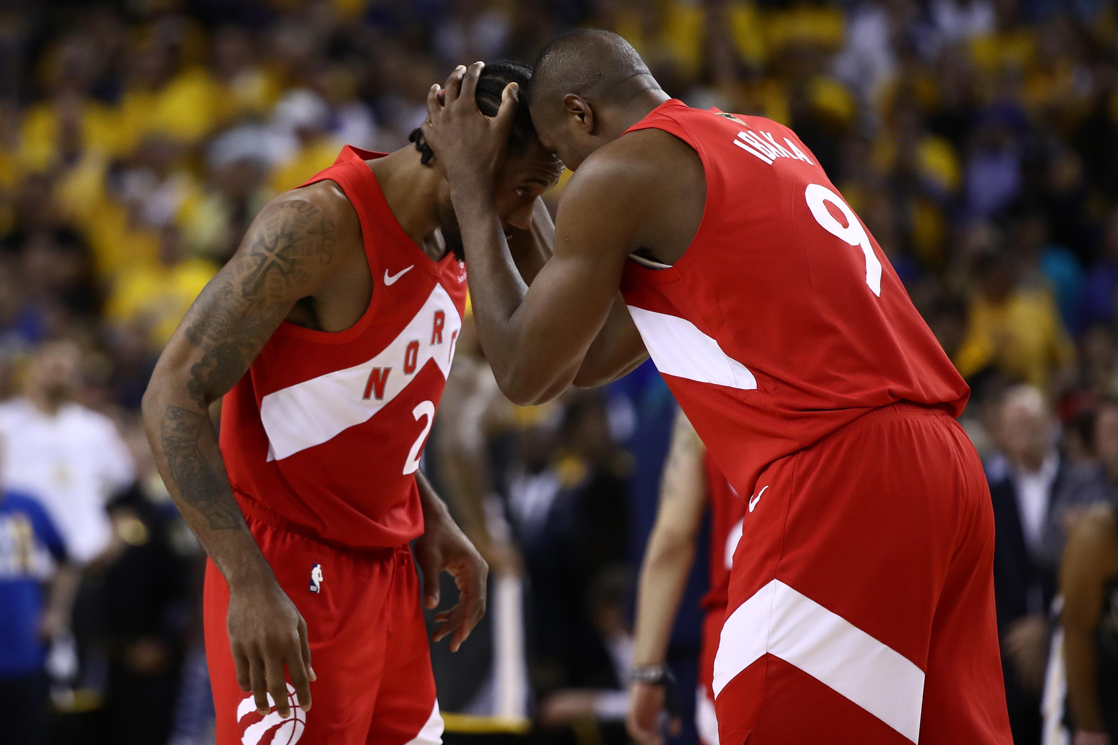Kawhi Leonard and Serge Ibaka of the Toronto Raptors celebrate a win