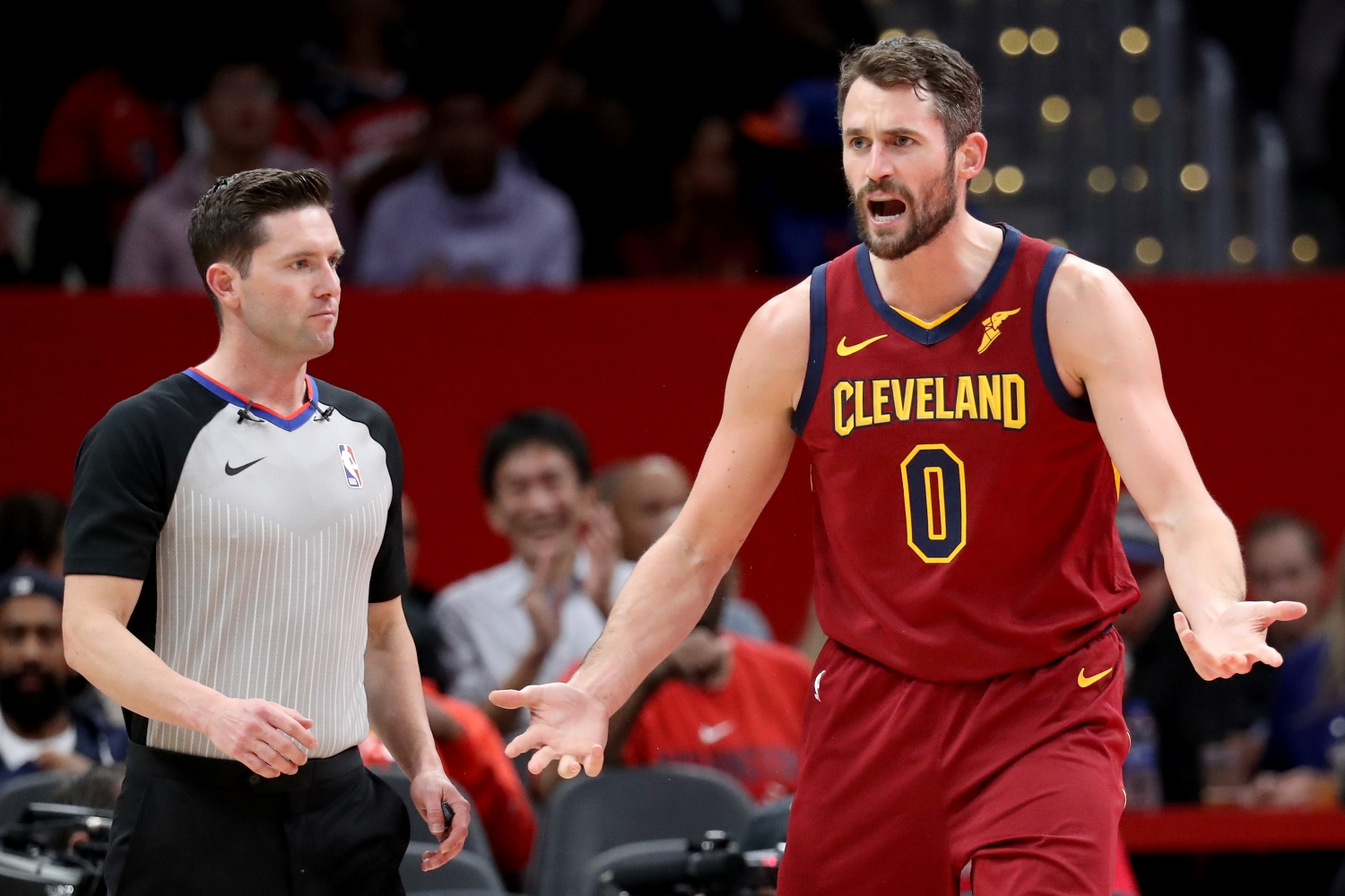 Cleveland Cavaliers forward Kevin Love argues a call with a referee.