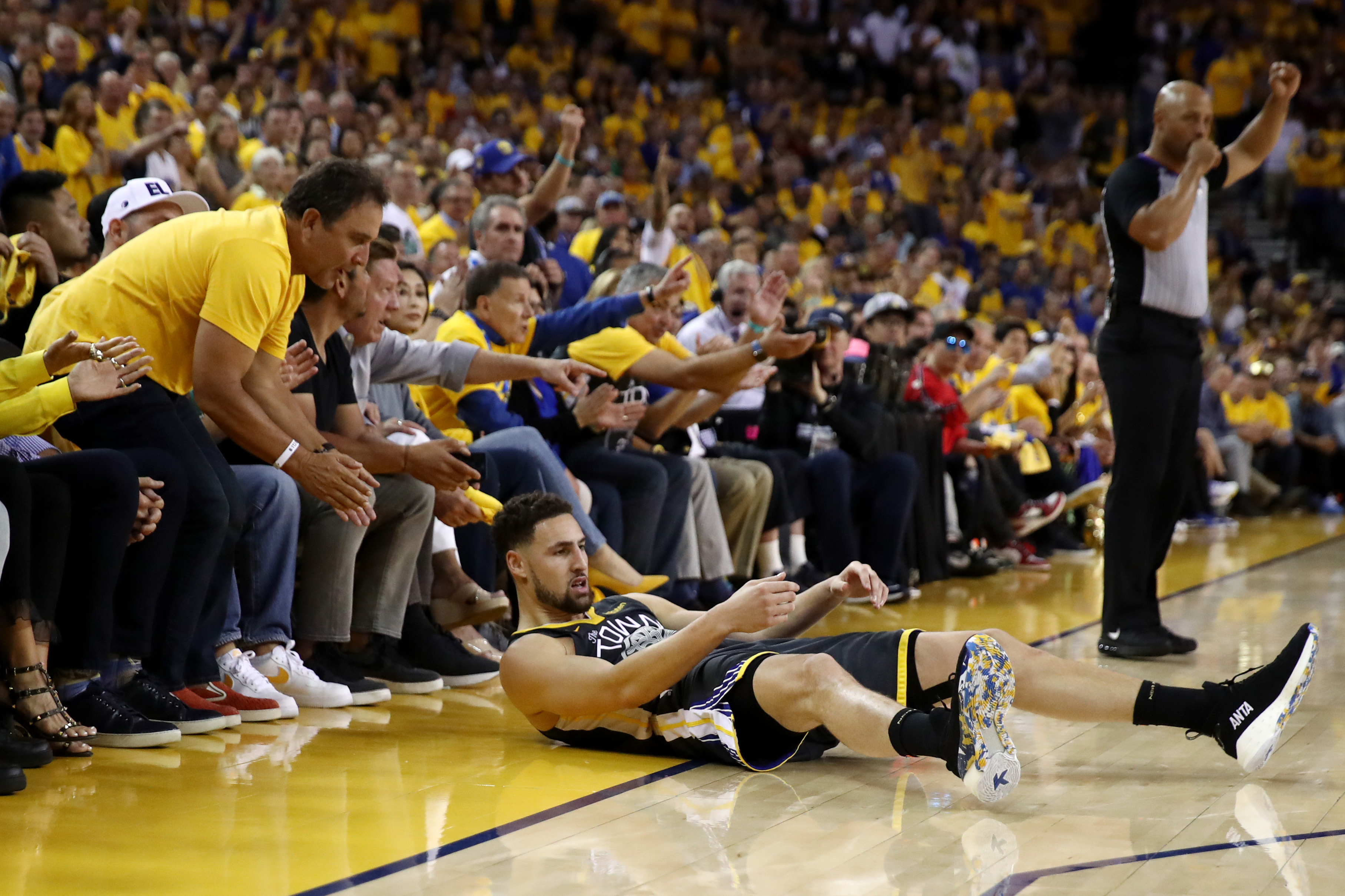 Klay Thompson of the Warriors slides across the court during Game 6 of the 2019 NBA Finals