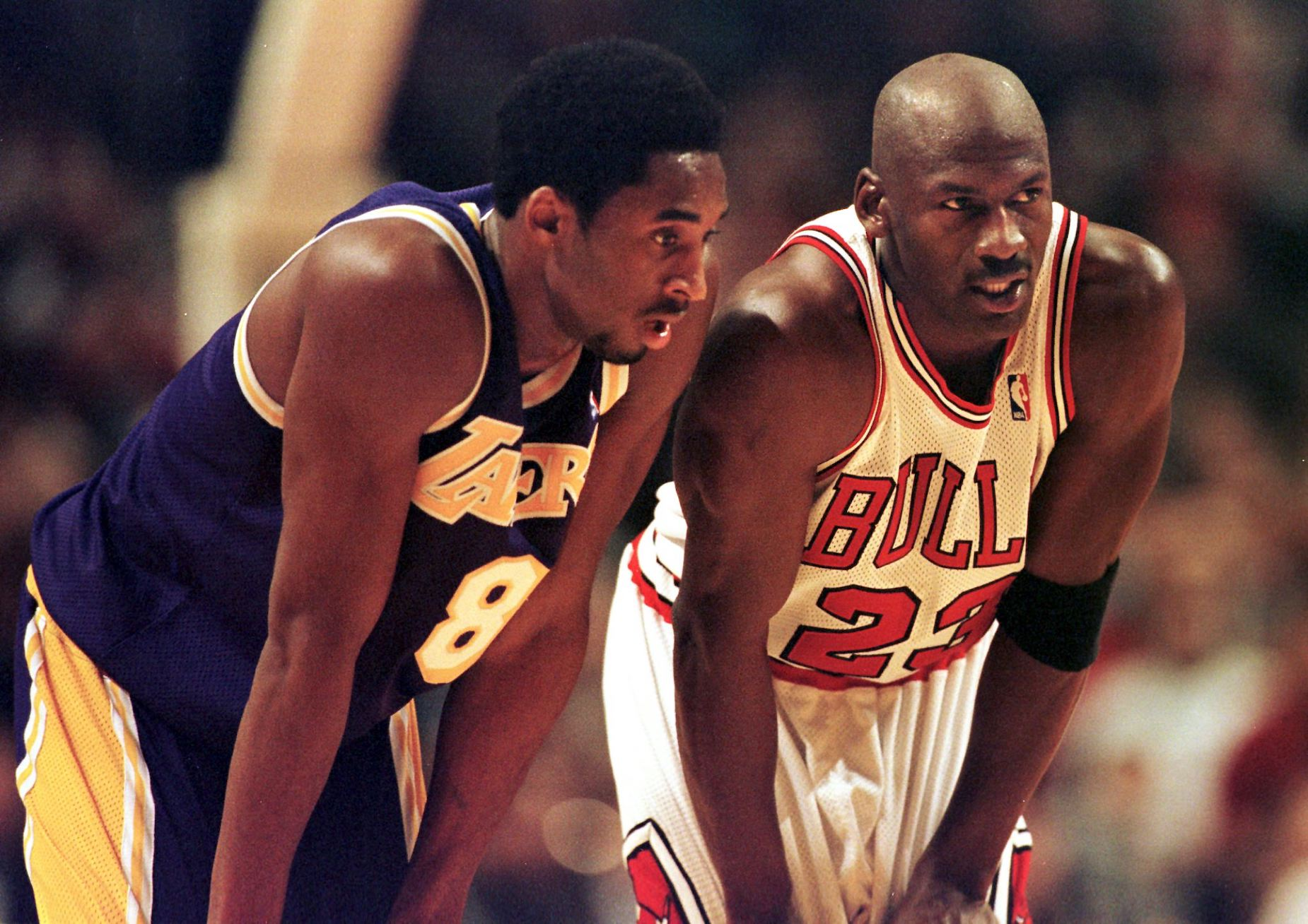 Kobe Bryant and Michael Jordan talk during a 1997 NBA game