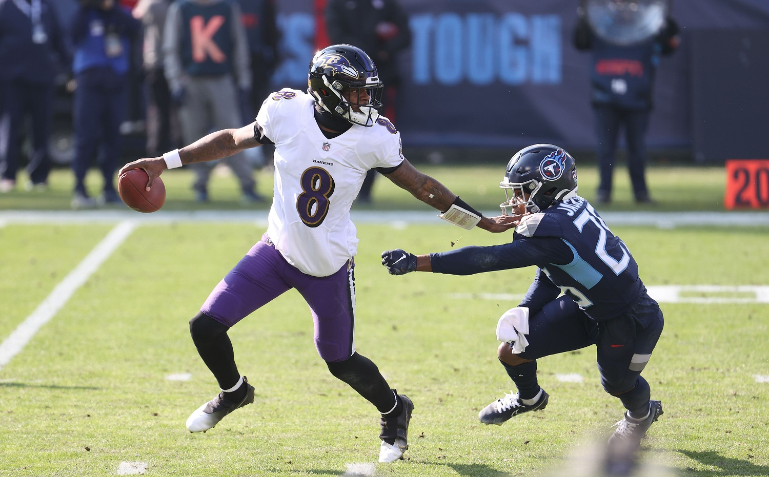 Lamar Jackson scrambles against the Tennessee Titans in the wild-card round of the NFL playoffs on Jan. 10, 2021. | Andy Lyons/Getty Images